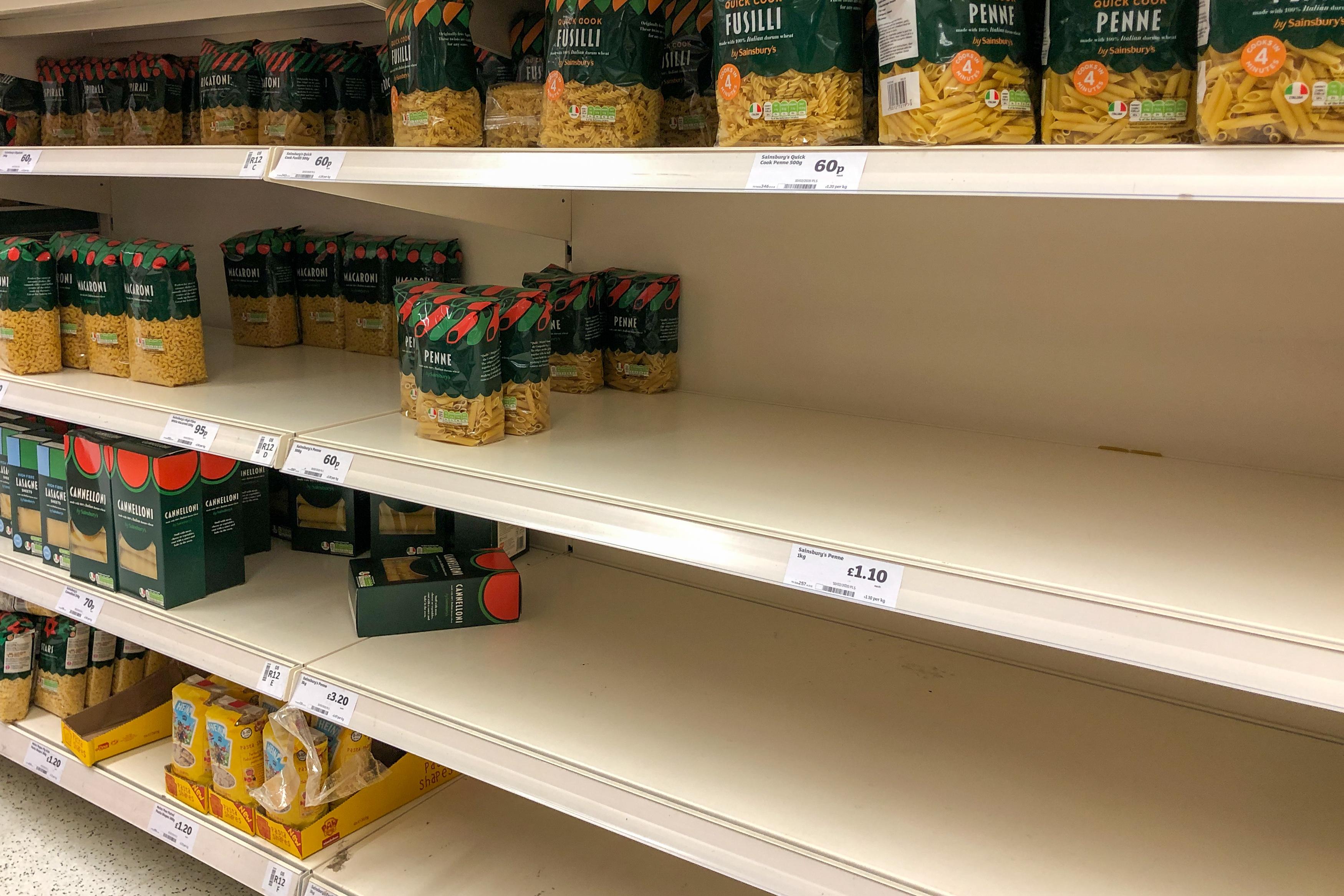 A shortage of pasta on the shelves at a Sainsbury's supermarket in Cambridge, as Prime Minister Boris Johnson announces the government's coronavirus action plan.