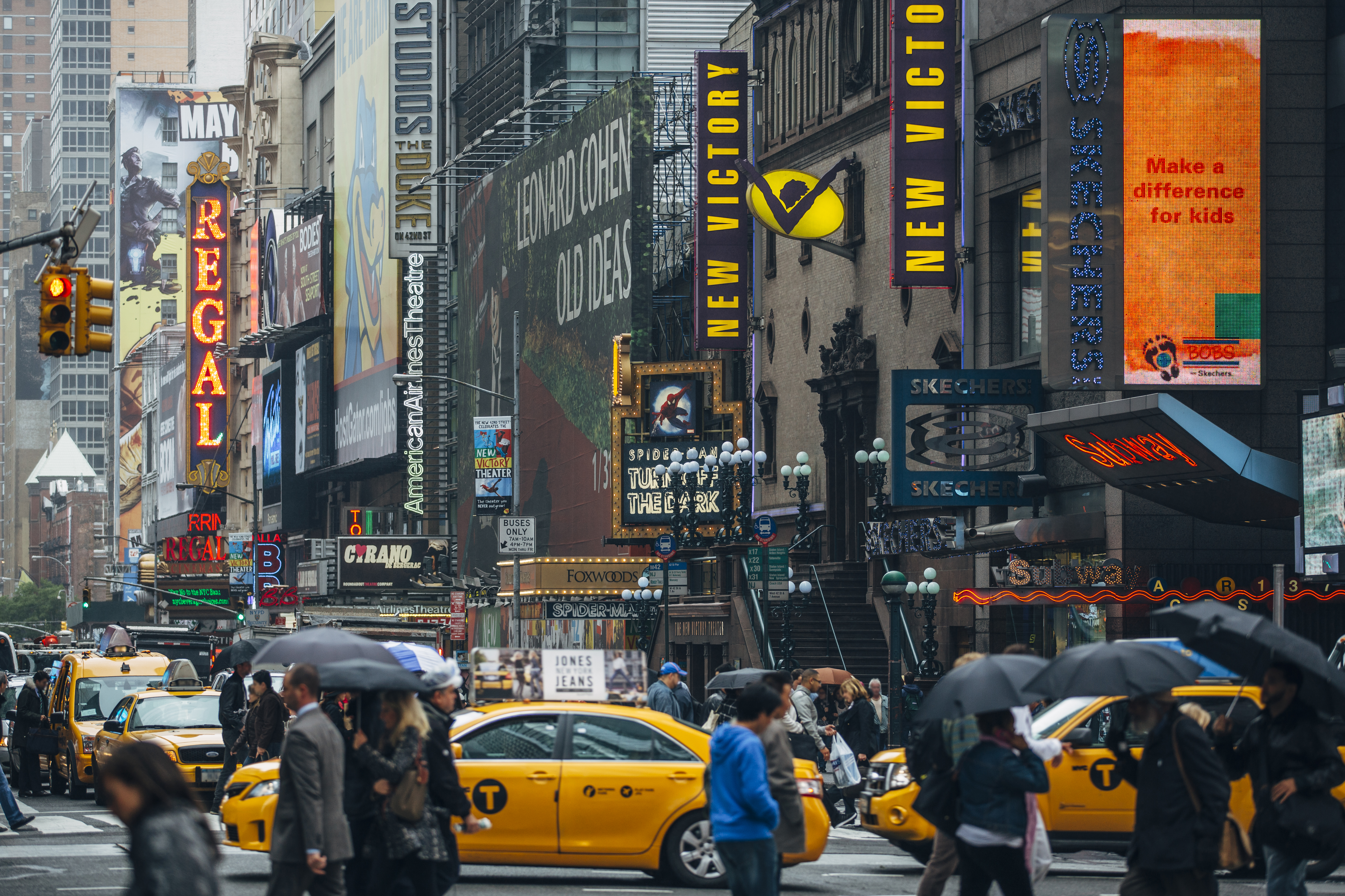 Broadway theater billboards and city traffic, New York City, NY, USA