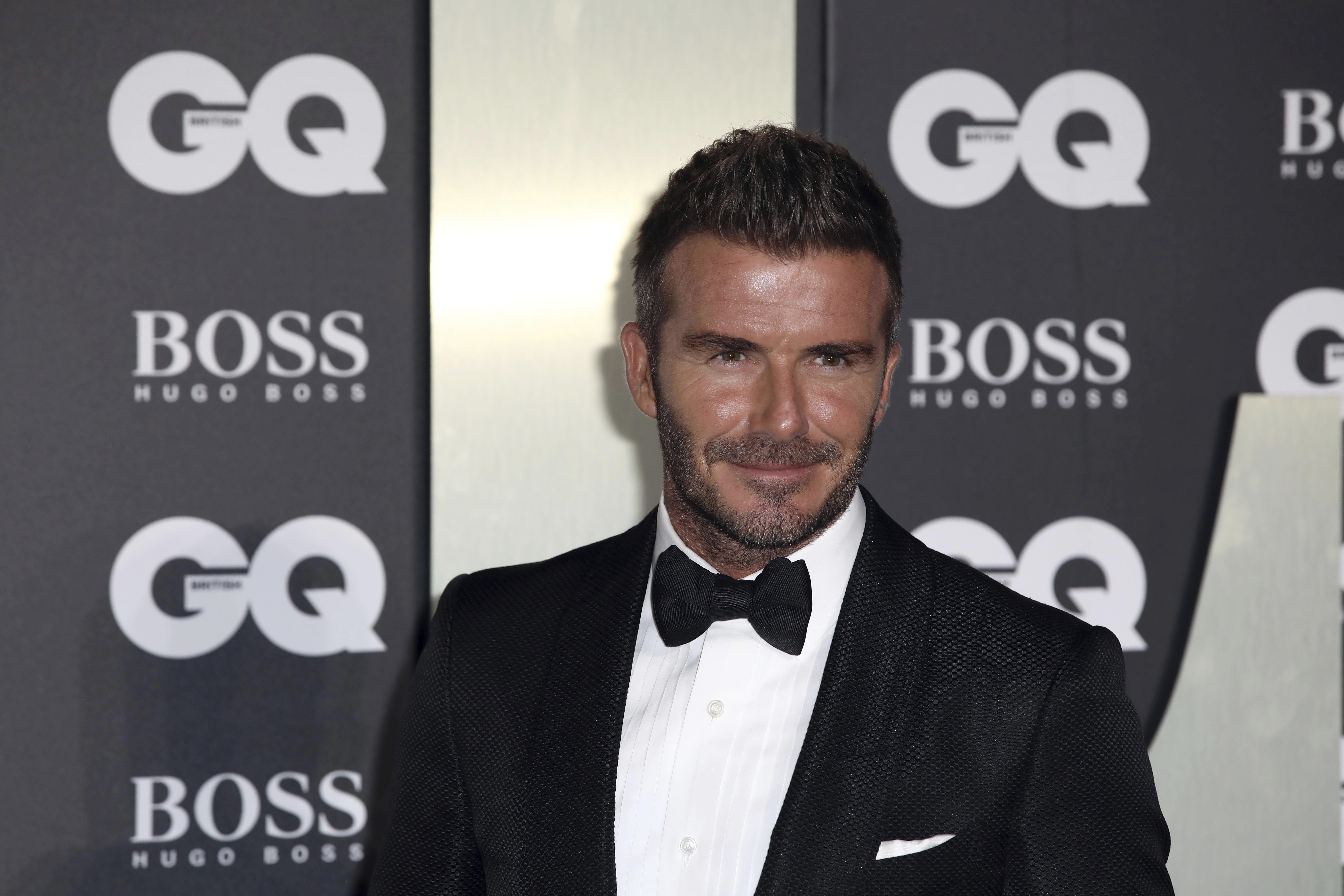 Footballer David Beckham poses for photographers on arrival at the GQ Men of the year Awards in central London on Tuesday, Sept. 3, 2019. (Photo by Grant Pollard/Invision/AP)