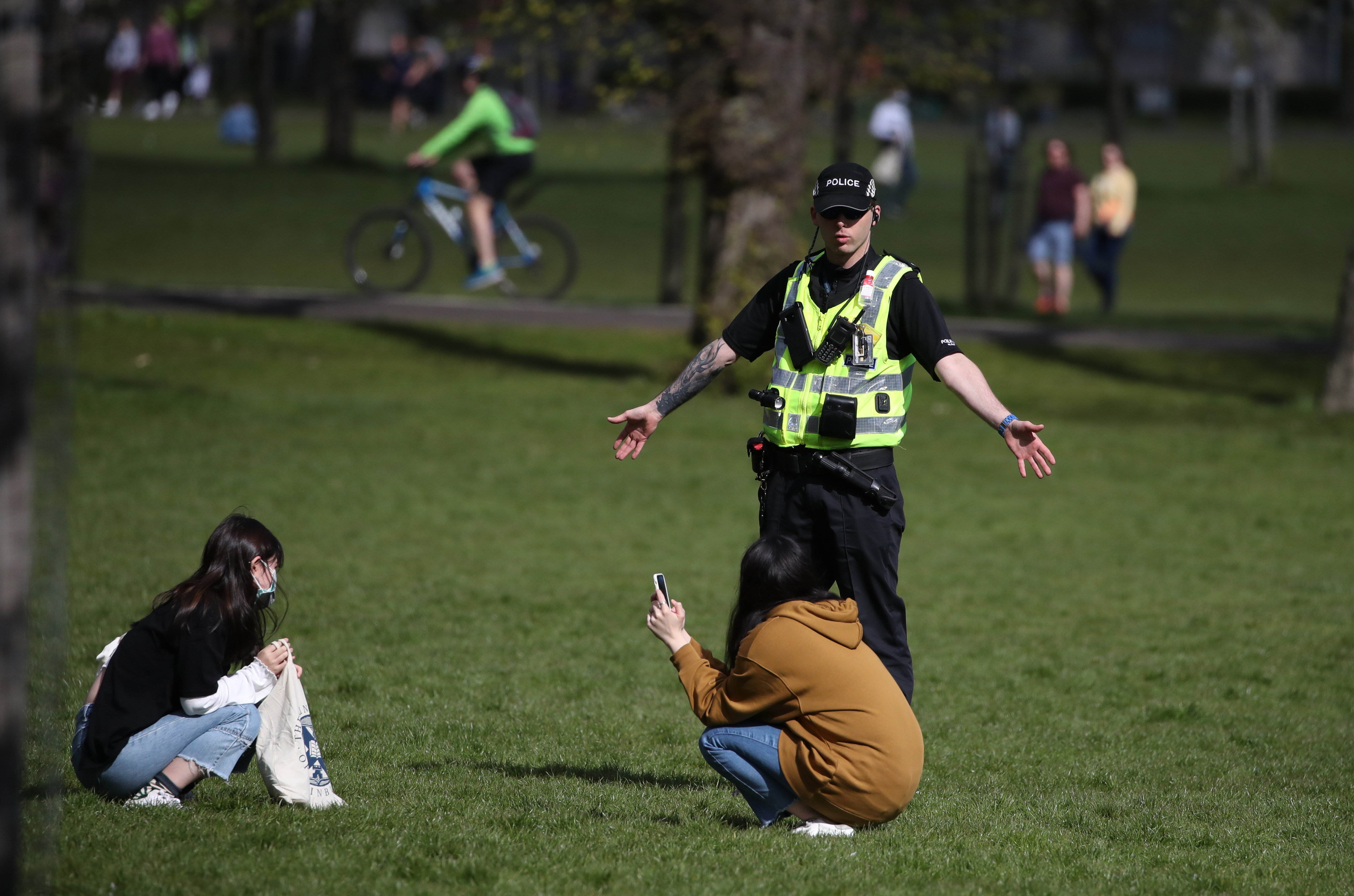 Police officers patrol in the Meadows in Edinburgh as the UK continues in lockdown to help curb the spread of the coronavirus.