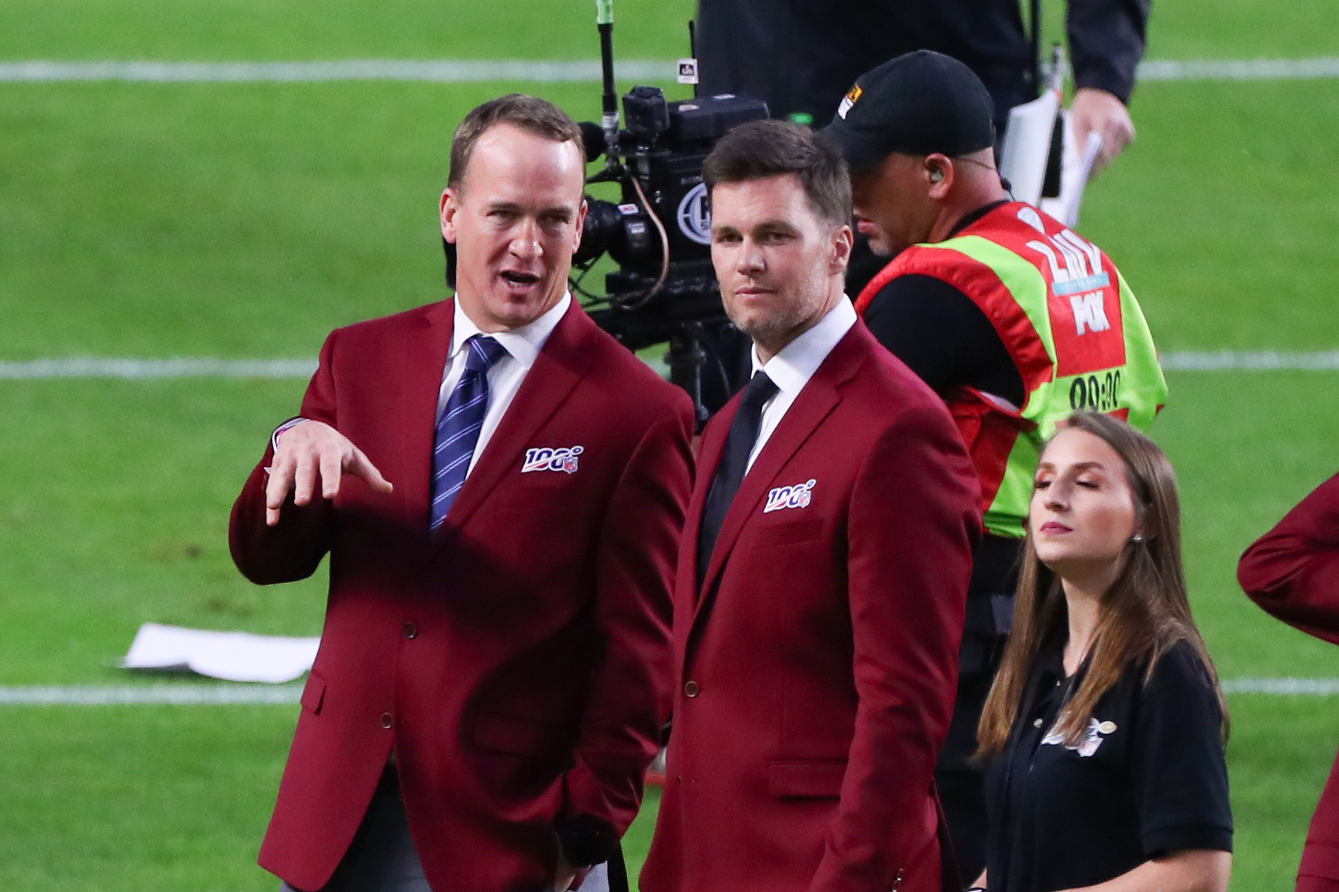 MIAMI GARDENS, FL - FEBRUARY 02: Tom Brady and Peyton Manning talk on the field during the 100 year team celebration prior to Super Bowl LIV on February 2, 2020 at Hard Rock Stadium in Miami Gardens, FL. (Photo by Rich Graessle/PPI/Icon Sportswire via Getty Images)