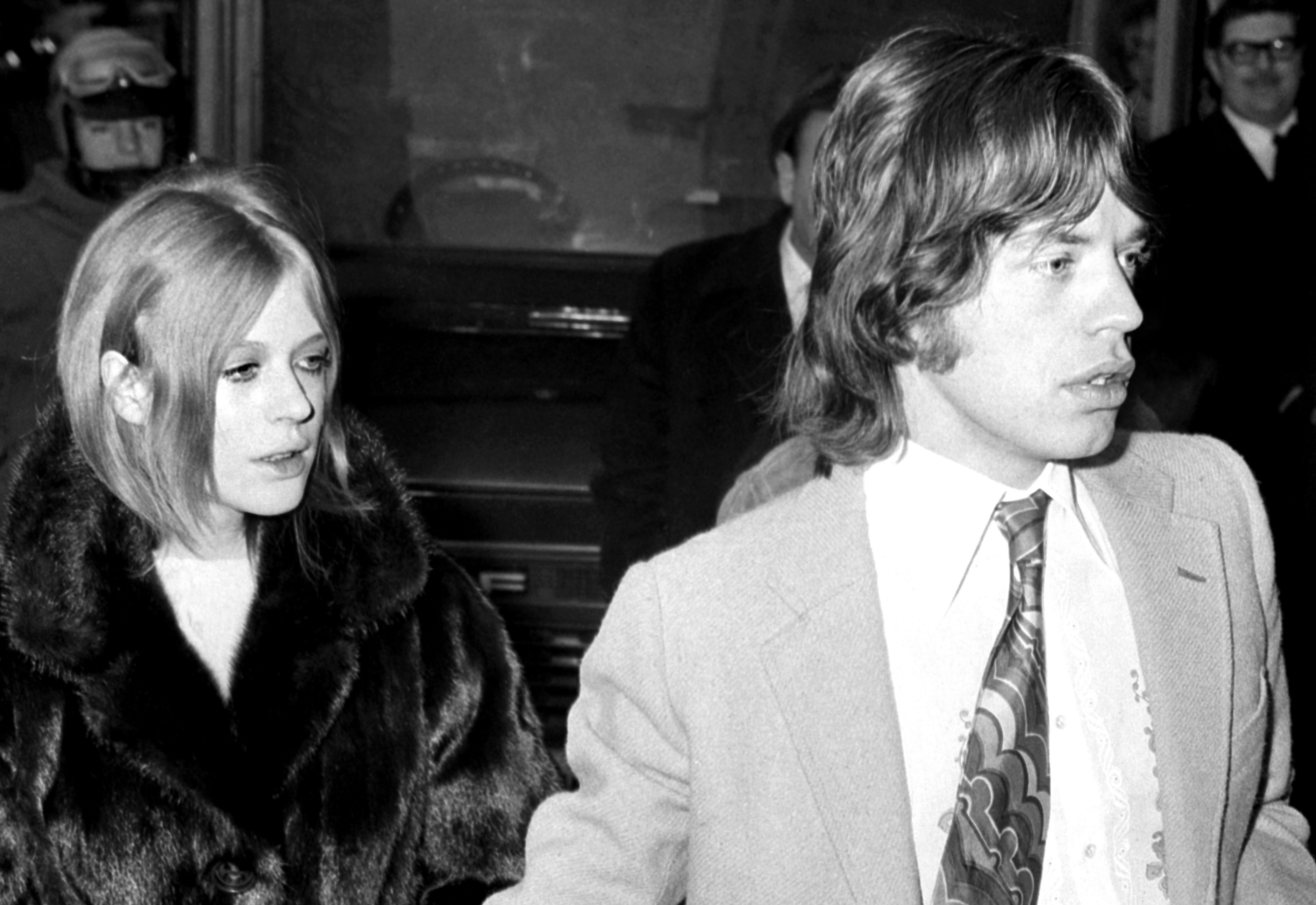 Mick Jagger, lead singer of the Rolling Stones, and Marianne Faithfull before they were due to appear in Marlborough Street Court on charges of possessing cannibis.   (Photo by PA Images via Getty Images)