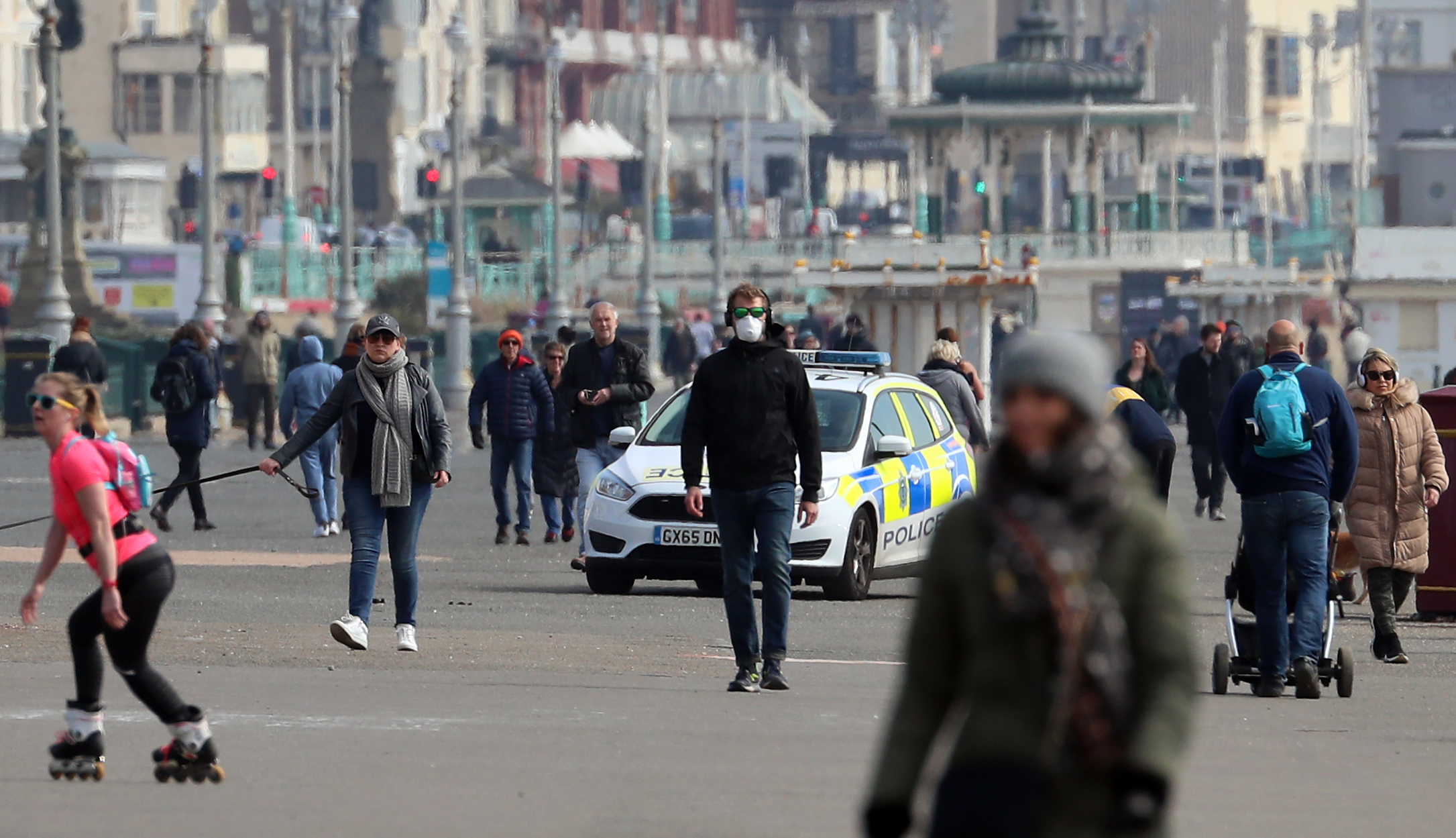A Sussex Police patrol car moves amongst people walking along the promenade in Brighton as the UK continues in lockdown to help curb the spread of the coronavirus. (Photo by Gareth Fuller/PA Images via Getty Images)