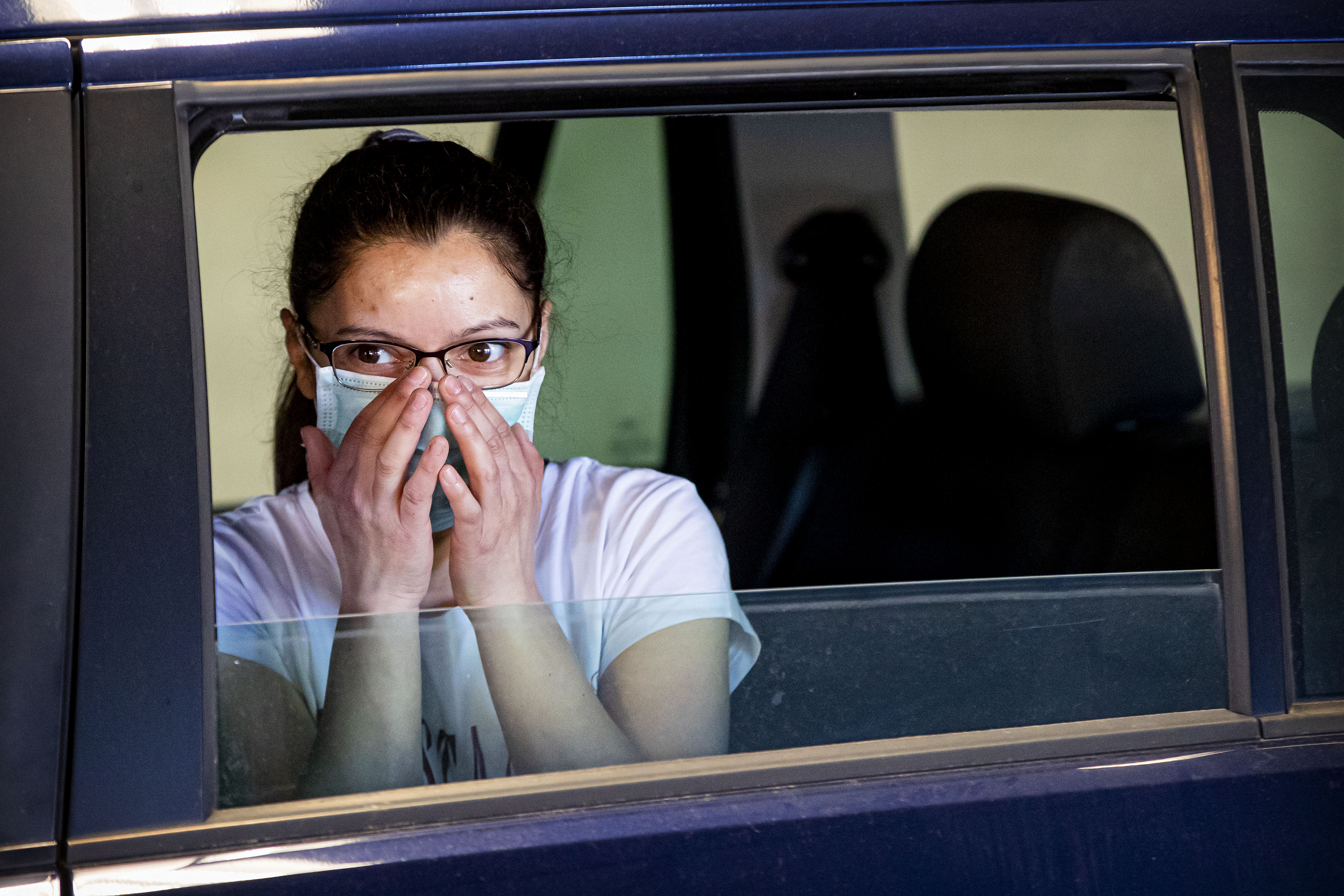 DORDRECHT, NETHERLANDS - APRIL 21: A girl with a face masks watches as Medical staff from the Medical Service Dordrecht test people with symptoms of COVID-19 at a drive in location on April 21, 2020 in Tiel, Netherlands. The price of the test is 70 euros. Instead of adopting a hard lockdown similar to its European neighbours, the Netherlands opted for a targeted lockdown, which allows some shops to continue if there was a low risk of spreading the virus. The coronavirus (COVID-19) pandemic has spread to many countries across the world, claiming over 176,000 lives and infecting more than 2.5 million people. (Photo by Patrick van Katwijk/Getty Images)