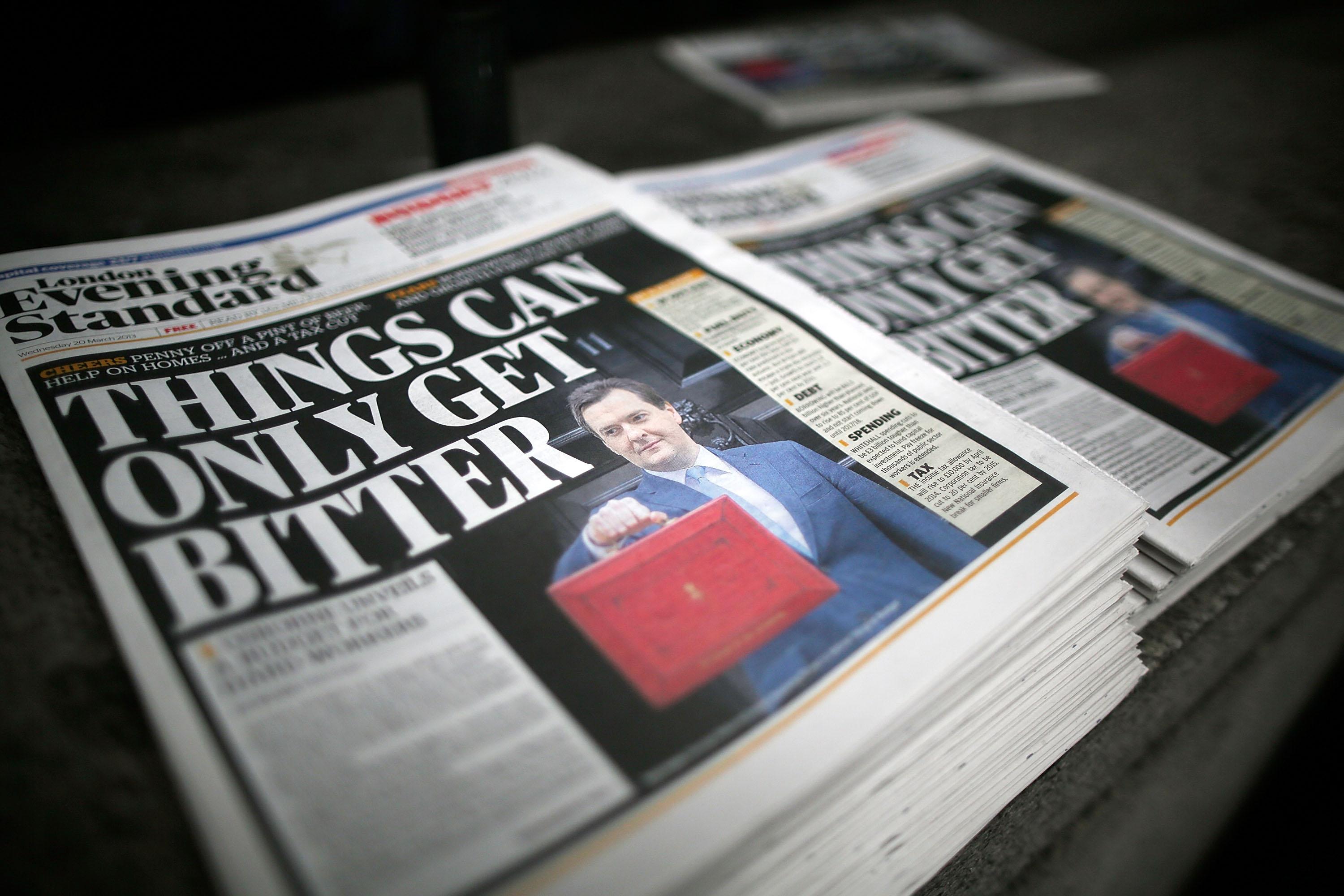 LONDON, ENGLAND - MARCH 20:  The London Evening Standards carries a front page story on the Chancellor George Osborne's budget, which was leaked on the paper's Twitter account, prior to the Chancellor's Commons statement on March 20, 2013 in London, England. The Chancellor is under pressure after the UK lost its AAA credit rating last month and the lack of growth in the economy, is predicted to reveal plans to continue with his austerity strategy to cut the UK's deficit. It is likely that Mr. Osborne will announce further spending cuts to Whitehall departments with the savings put in place to boost large scale infrastructure projects, with both tax breaks on childcare and a rise in fuel duty also high on the agenda.  (Photo by Matthew Lloyd/Getty Images)
