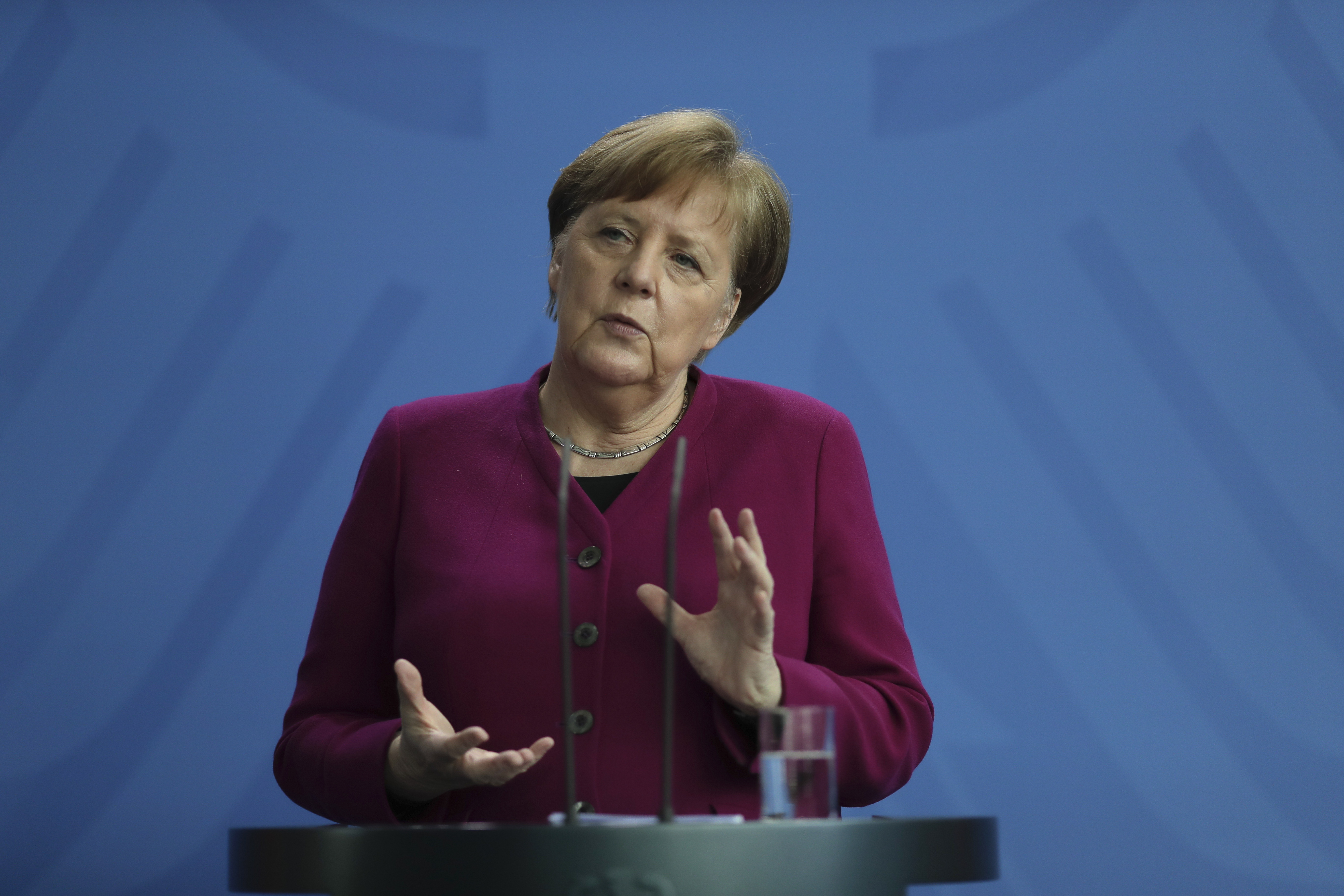 German Chancellor Angela Merkel briefs the media about measures of the German government to avoid further spread of the coronavirus at the chancellery in Berlin, Germany, Thursday, April 9, 2020. In order to slow down the spread of the coronavirus, the German government has considerably restricted public life and asked the citizens to stay at home. The new coronavirus causes mild or moderate symptoms for most people, but for some, especially older adults and people with existing health problems, it can cause more severe illness or death. (AP Photo/Markus Schreiber, Pool)