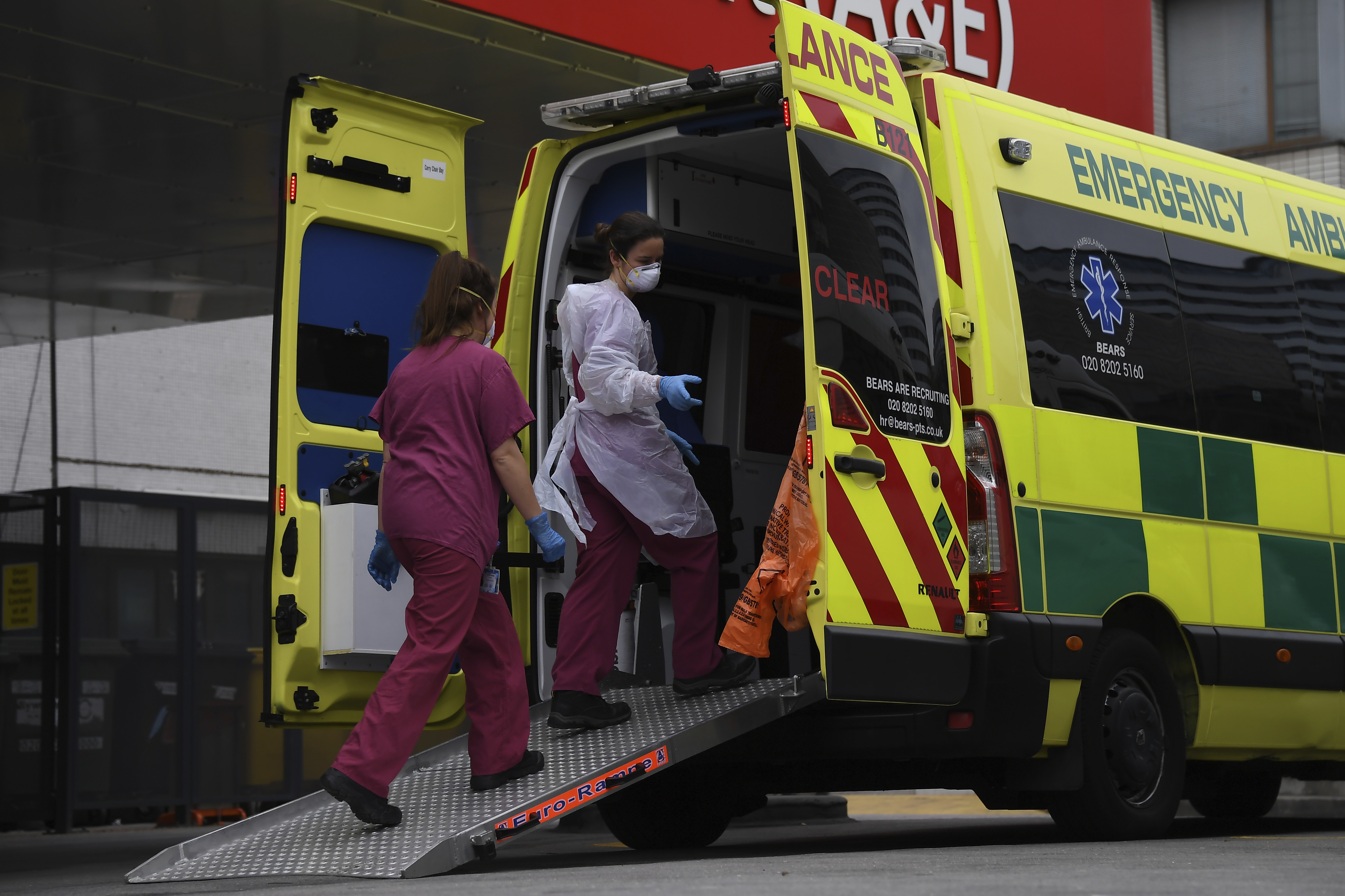 Medical workers clean an ambulance at St Thomas' Hospital, one of the many hospitals dealing with Coronavirus patients in London, Wednesday, April 1, 2020. The new coronavirus causes mild or moderate symptoms for most people, but for some, especially older adults and people with existing health problems, it can cause more severe illness or death.(AP Photo/Alberto Pezzali)