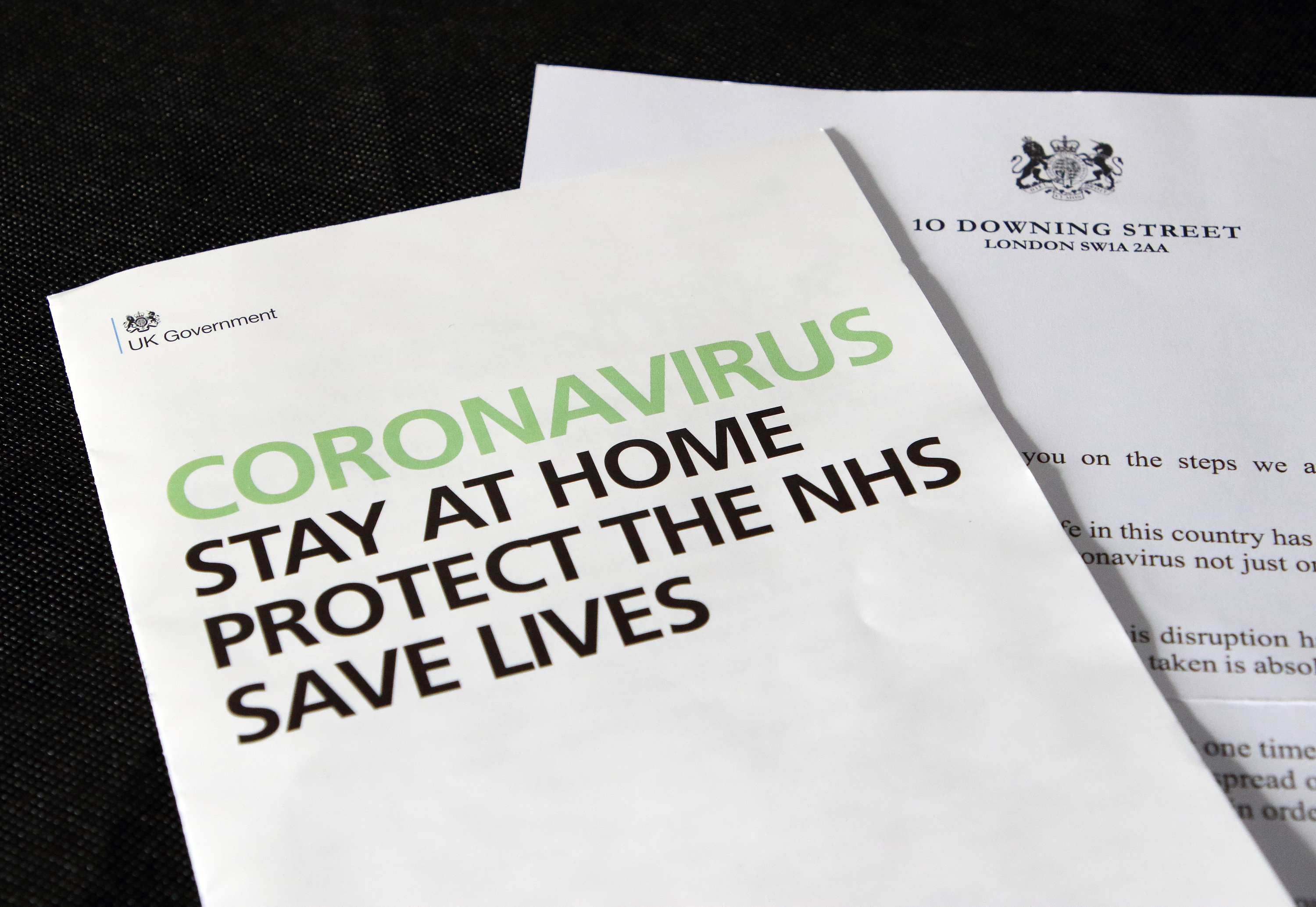 In this photo illustration, a letter from the British Prime Minster and HM Government Coronavirus leaflet are seen on display. A coronavirus letter from the British Prime Minister Boris Johnson to be sent to every UK household urging the public to stay home. Around 30 million UK households will receive the Covid-19 letter, along with a leaflet about Coronavirus symptoms, guidelines and awareness. (Photo by Keith Mayhew / SOPA Images/Sipa USA)