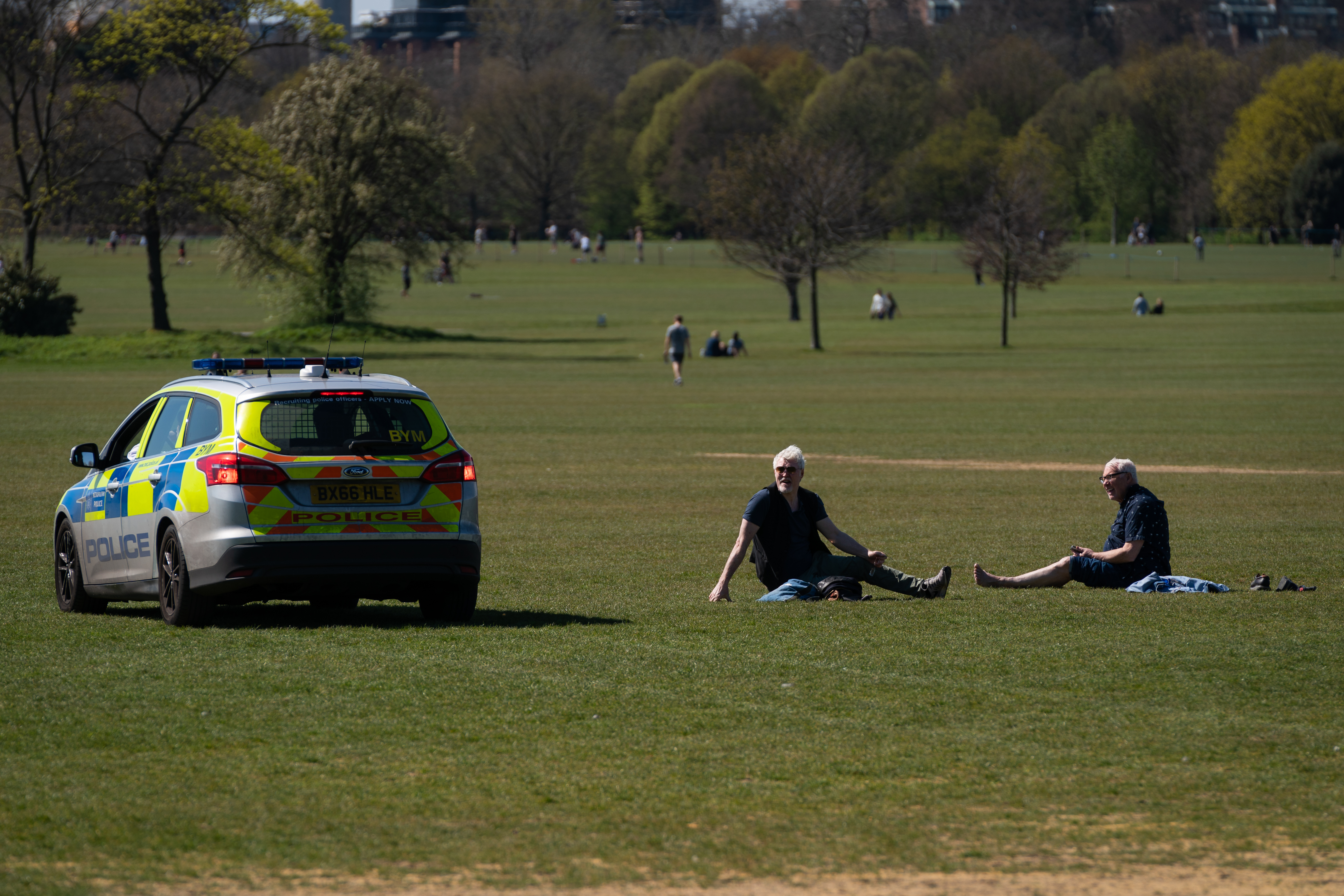 Police move on sunbathers in Regents Park, London, as the UK continues in lockdown to help curb the spread of the coronavirus.
