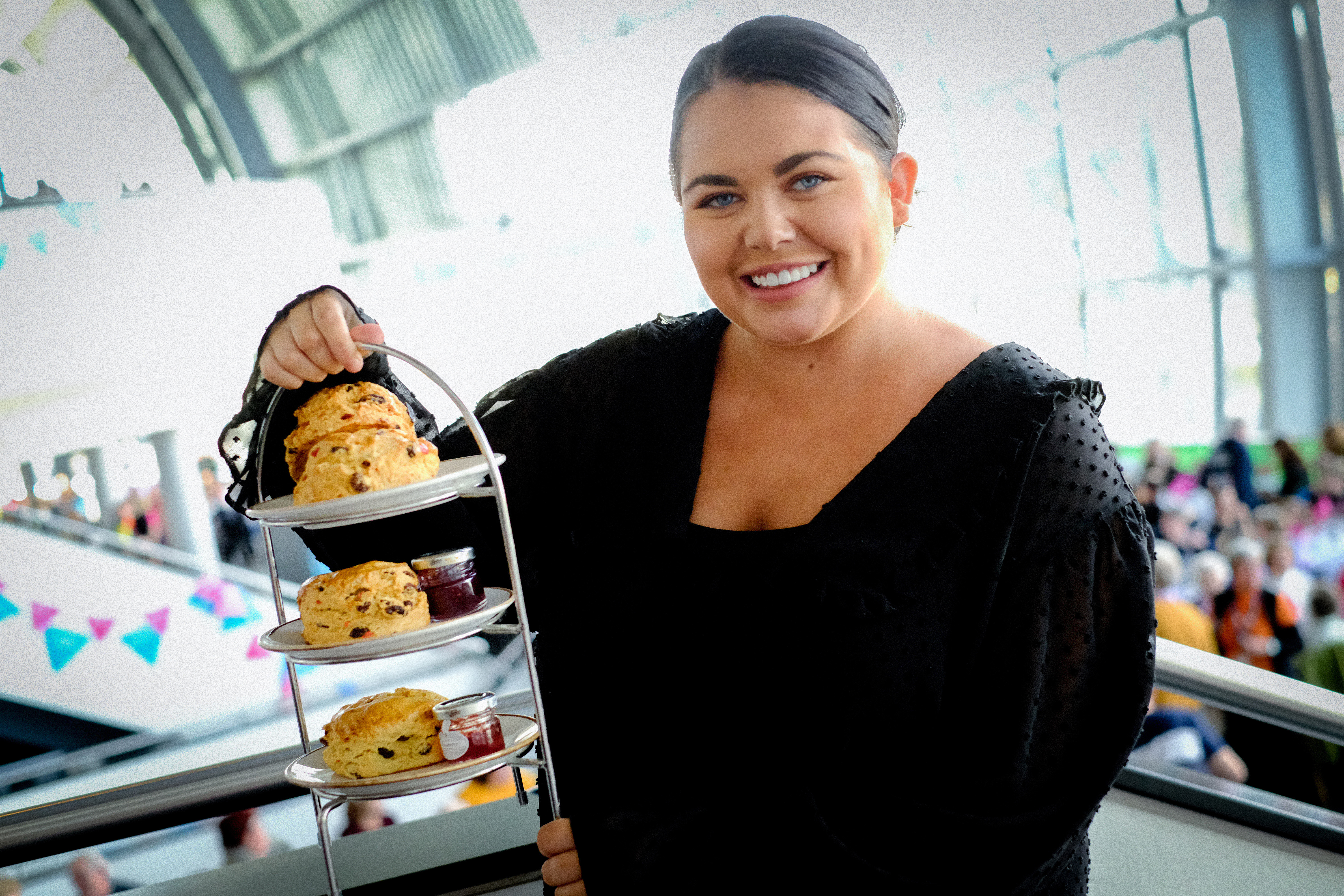GATESHEAD, ENGLAND - OCTOBER 23: TV personality, Scarlett Moffatt, hosted a Guinness World Records TM attempt for the Largest Cream Tea Party, incelebration of TheNational Lottery's 25thBirthdayand its impact on bringing people together, on October 23, 2019 in Gateshead, England. Scarlett was joined by community heroes from across the UK at Sage Gateshead. (Photo by Thomas Jackson/Getty Images for National Lottery)