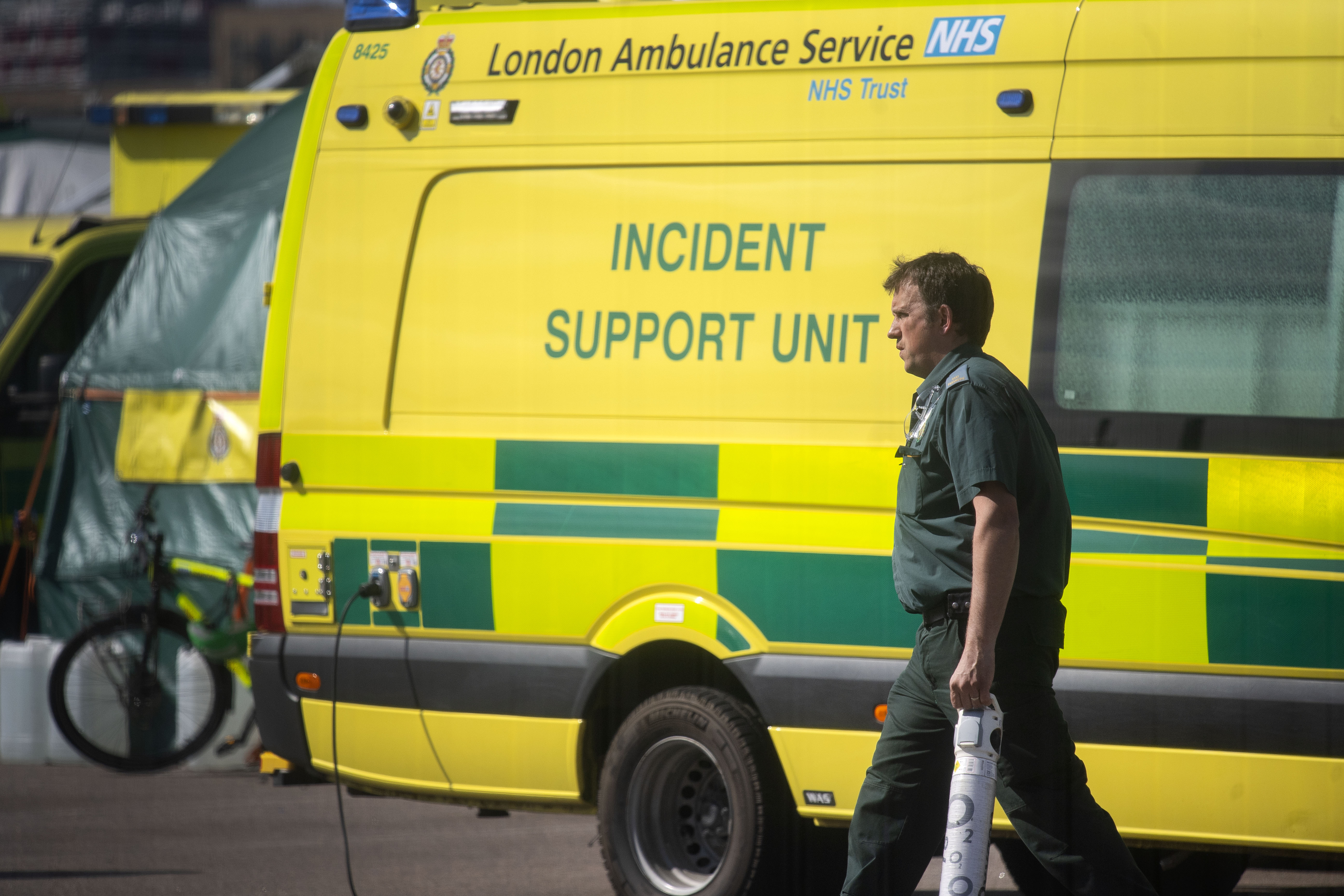 NHS workers prepare a line of ambulances outside at the NHS Nightingale Hospital at the Excel Centre in London as the UK continues in lockdown to help curb the spread of the coronavirus.