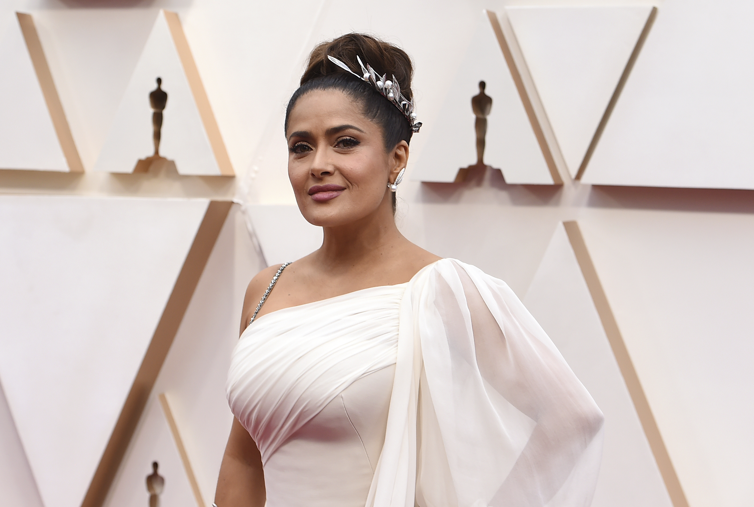 Salma Hayek arrives at the Oscars on Sunday, Feb. 9, 2020, at the Dolby Theatre in Los Angeles. (Photo by Jordan Strauss/Invision/AP)