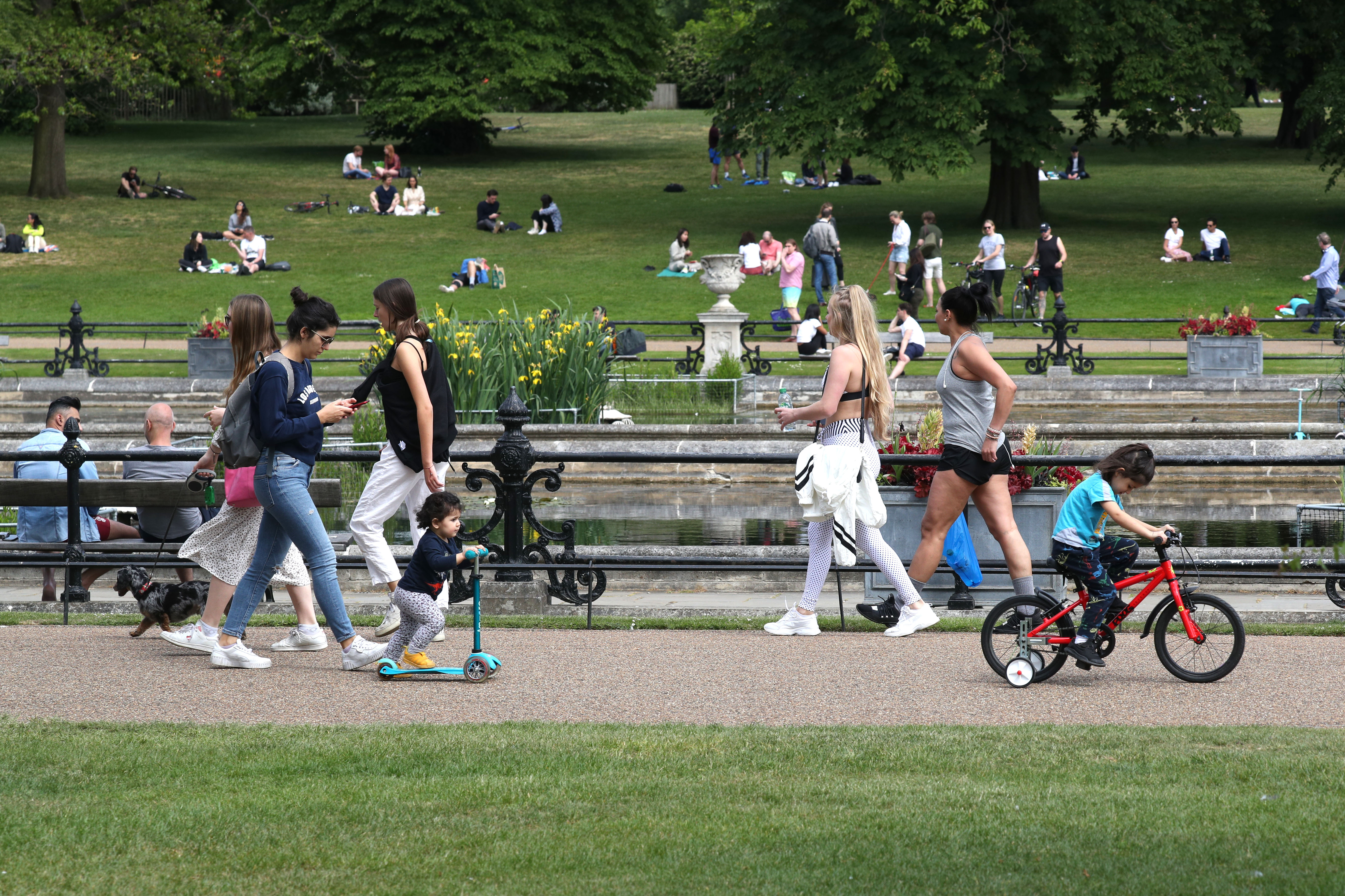People walking and exercising in Hyde Park in London after the introduction of measures to bring the country out of lockdown. (Photo by Jonathan Brady/PA Images via Getty Images)