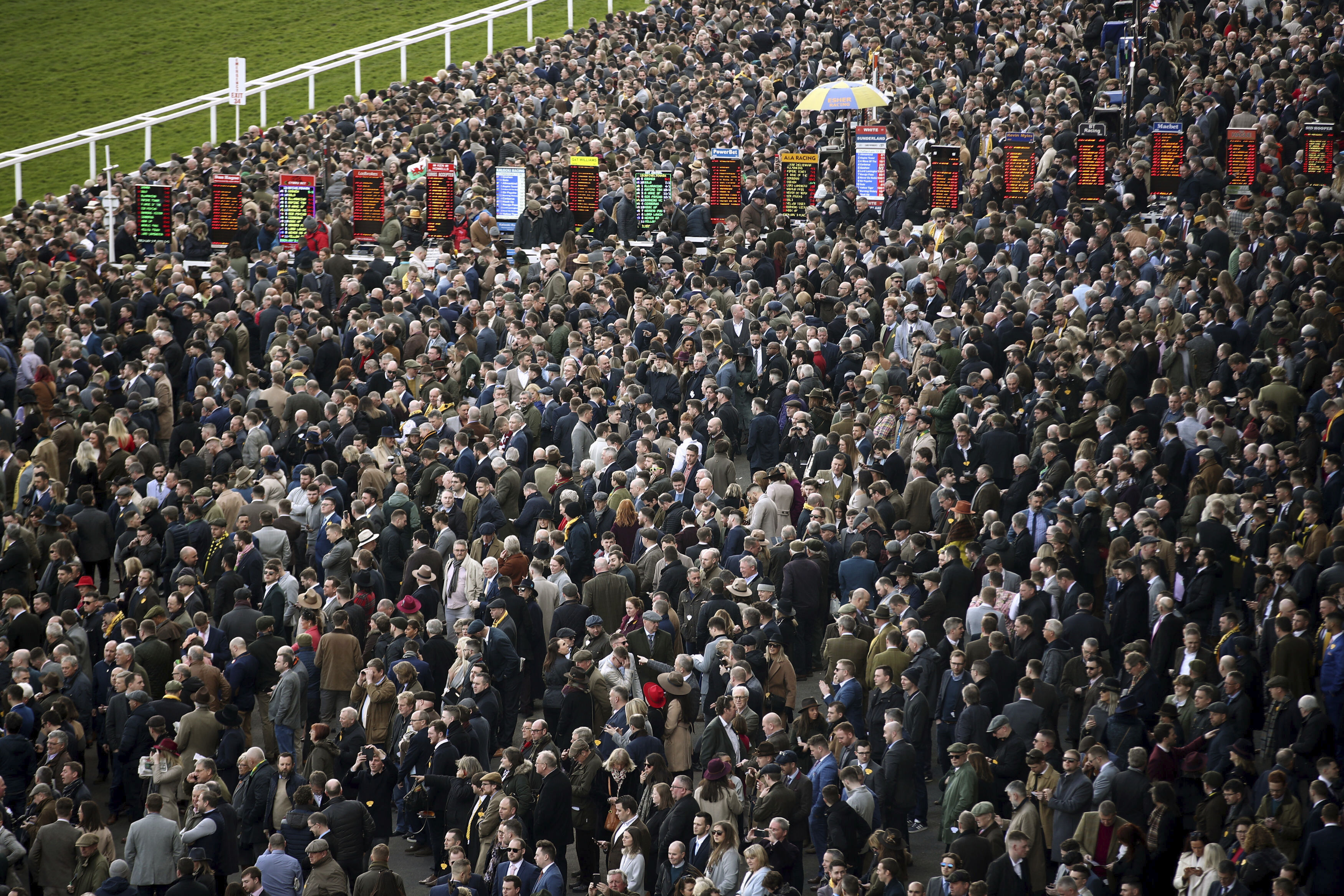Crowds during day four of the Cheltenham Festival at Cheltenham Racecourse in Cheltenham, England, Friday, March 13, 2020. (Tim Goode/PA via AP)