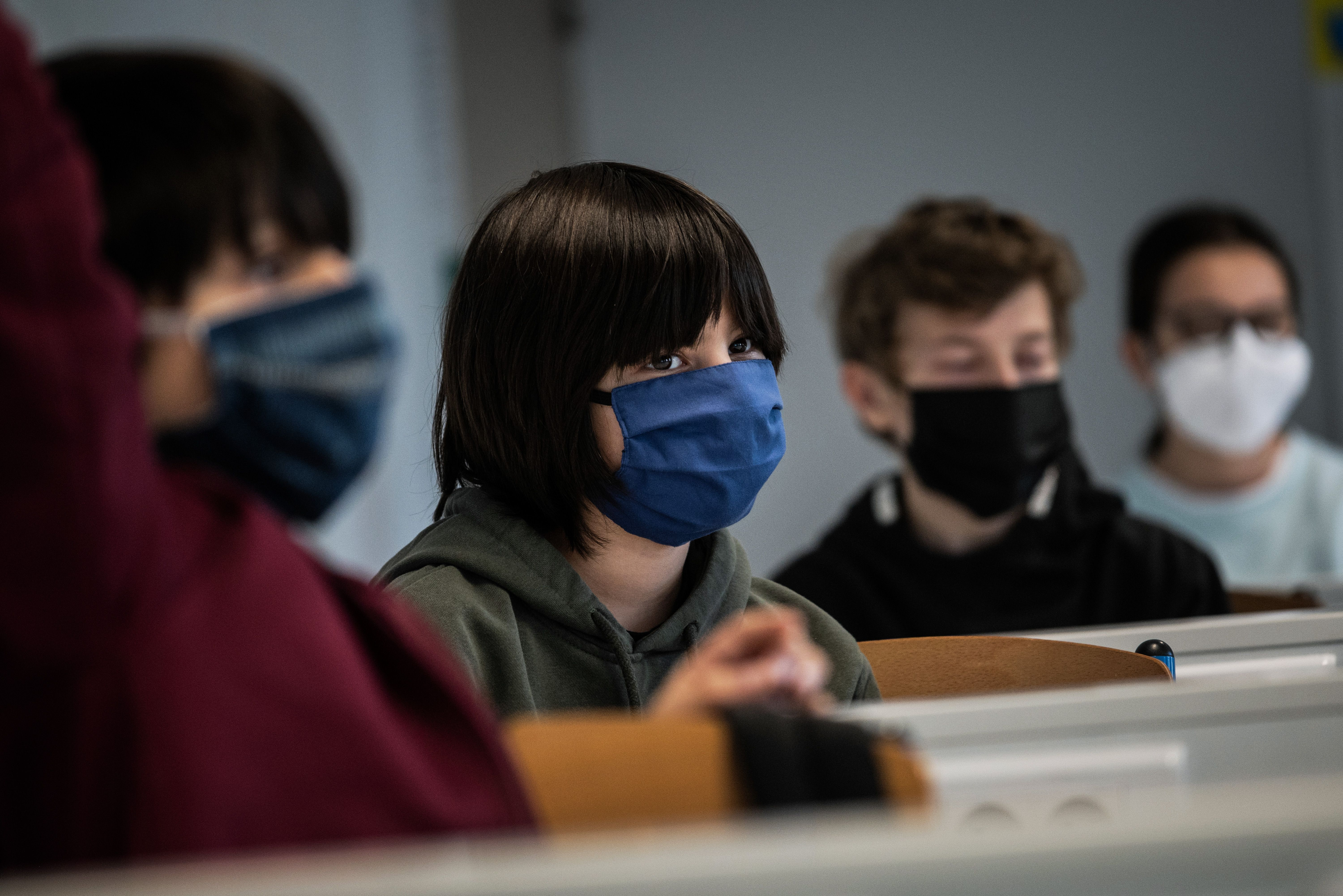 Schoolchildren attend a course in a middle school classroom, on May 18, 2020 in Lyon, central eastern France, after France eased lockdown measures to curb the spread of the COVID-19 pandemic, caused by the novel coronavirus. (Photo by JEFF PACHOUD / AFP) (Photo by JEFF PACHOUD/AFP via Getty Images)