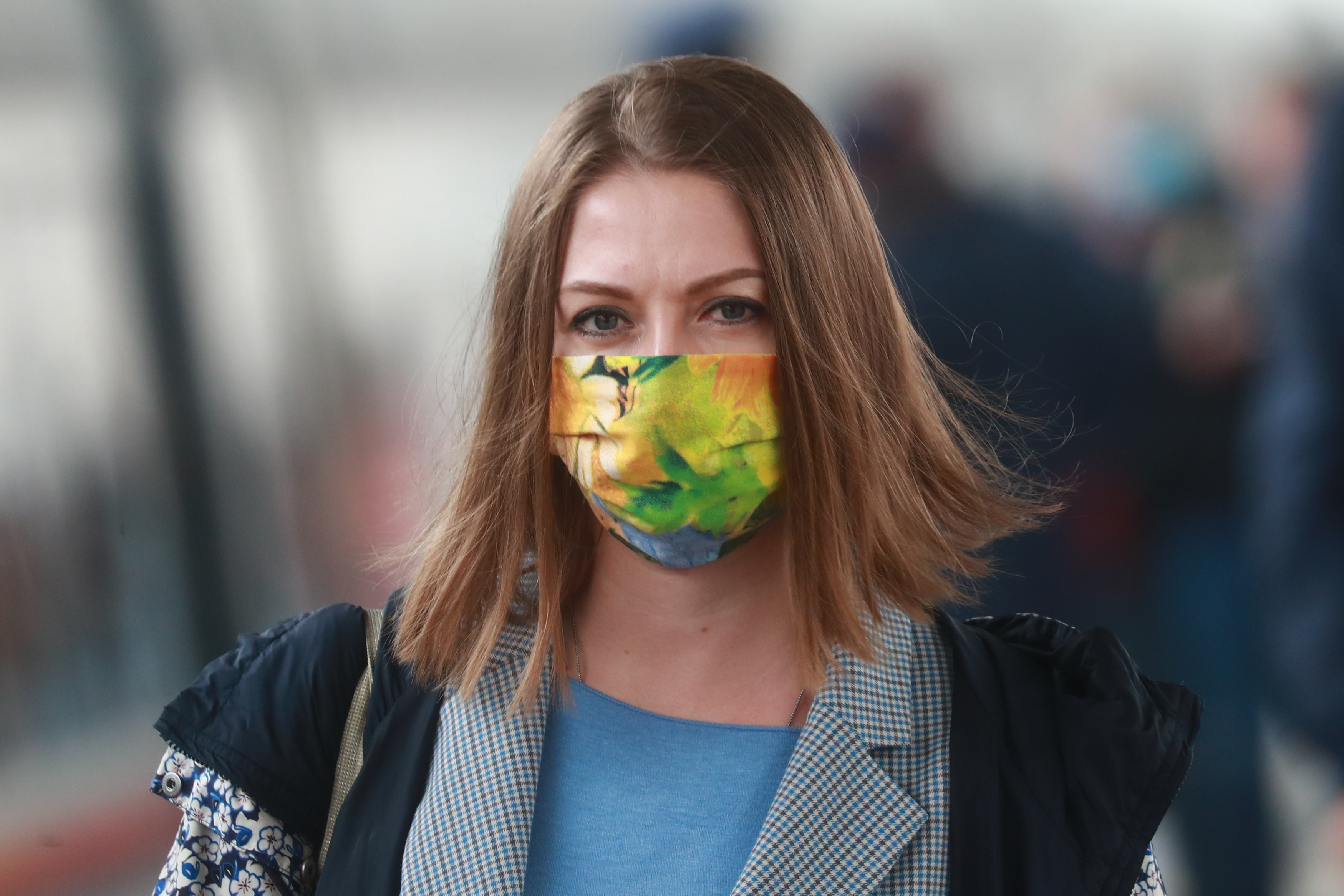 MOSCOW, RUSSIA - MAY 29, 2020: A young woman in a face mask at Leningradsky Railway Station. Starting from 29 May 2020, RZD Russian Railways is to increase by double the number of high speed trains that run between Moscow and St Petersburg. Sergei Fadeichev/TASS (Photo by Sergei Fadeichev\TASS via Getty Images)