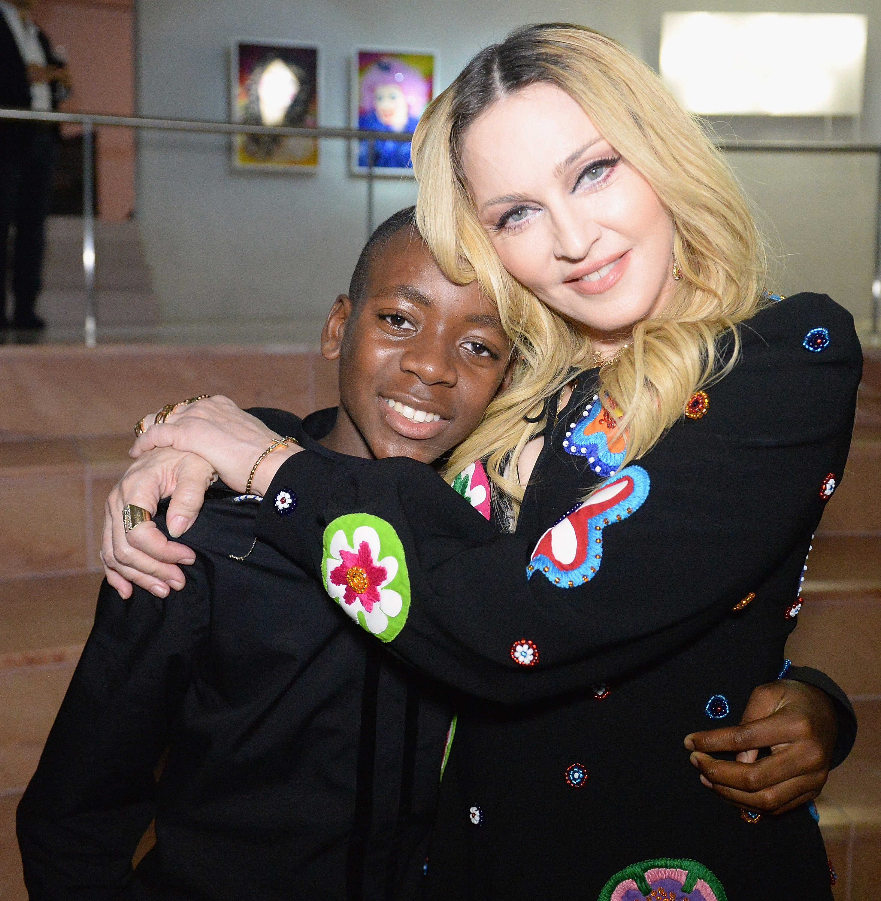 MIAMI BEACH, FL - DECEMBER 03:  David Banda and Madonna at her Evening of Music, Art, Mischief and Performance to Benefit Raising Malawi at Faena Forum on December 3, 2016 in Miami Beach, Florida.  (Photo by Kevin Mazur/Getty Images for Bulgari)