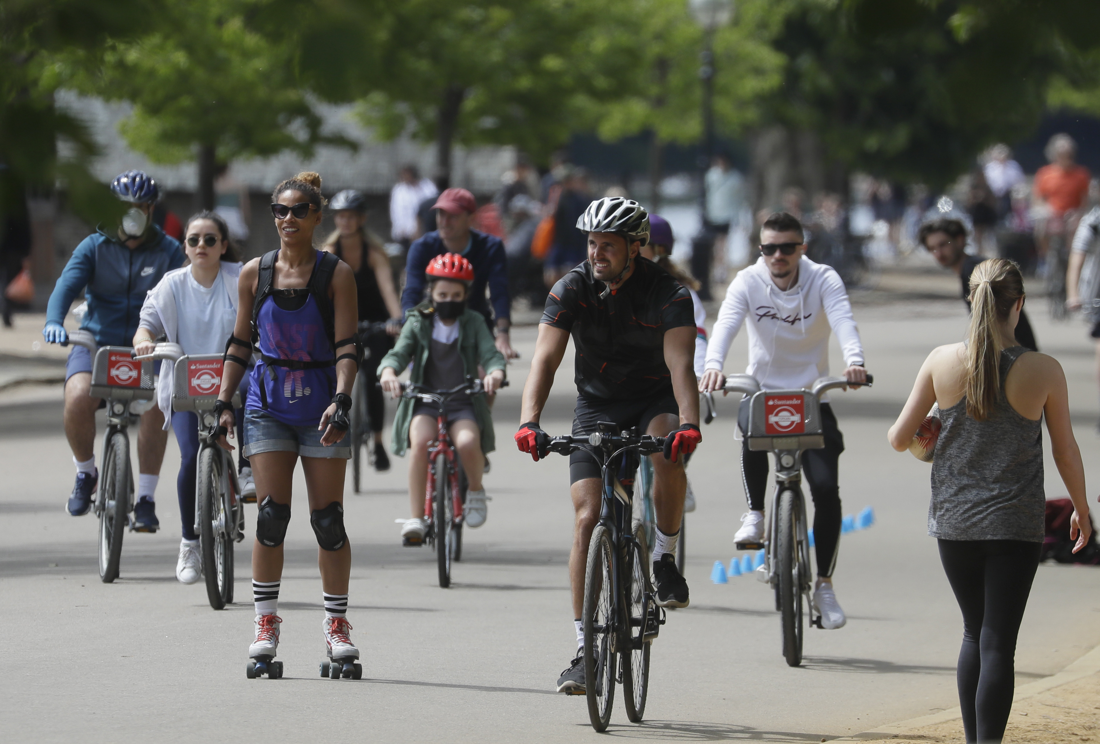 People exercise in Hyde Park as lockdown restrictions were relaxed to bring the country out of lockdown amid the coronavirus pandemic, in London, Sunday, May 17, 2020. (AP Photo/Kirsty Wigglesworth)