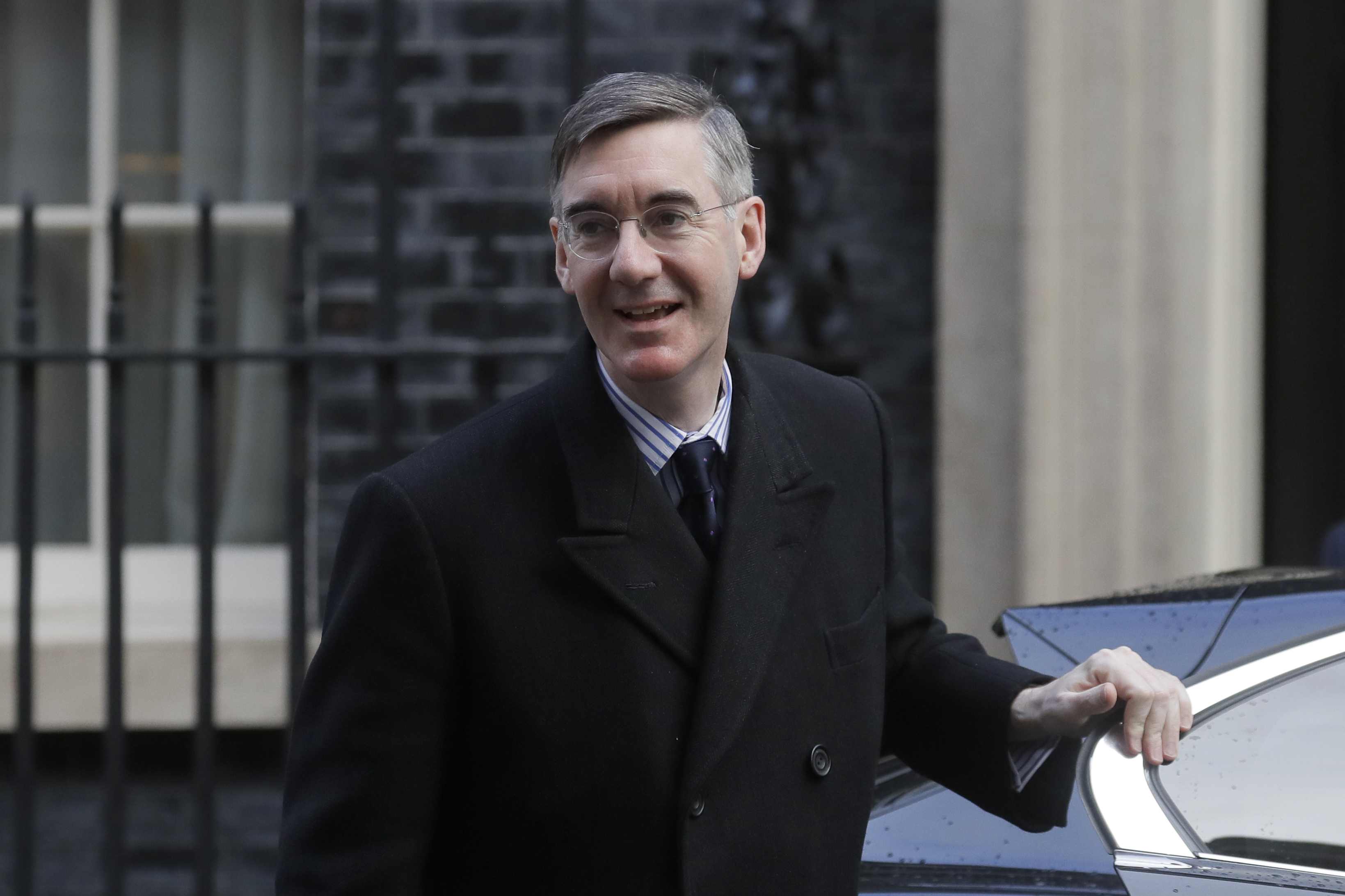 British lawmaker Jacob Rees-Mogg, Lord President of the Council, Leader of the House of Commons arrives in Downing Street for a Cabinet meeting ahead of the budget being announced in Parliament in London, Wednesday, March 11, 2020. Britain's Chancellor of the Exchequer Rishi Sunak will announce the first budget since Britain left the European Union. (AP Photo/Kirsty Wigglesworth)