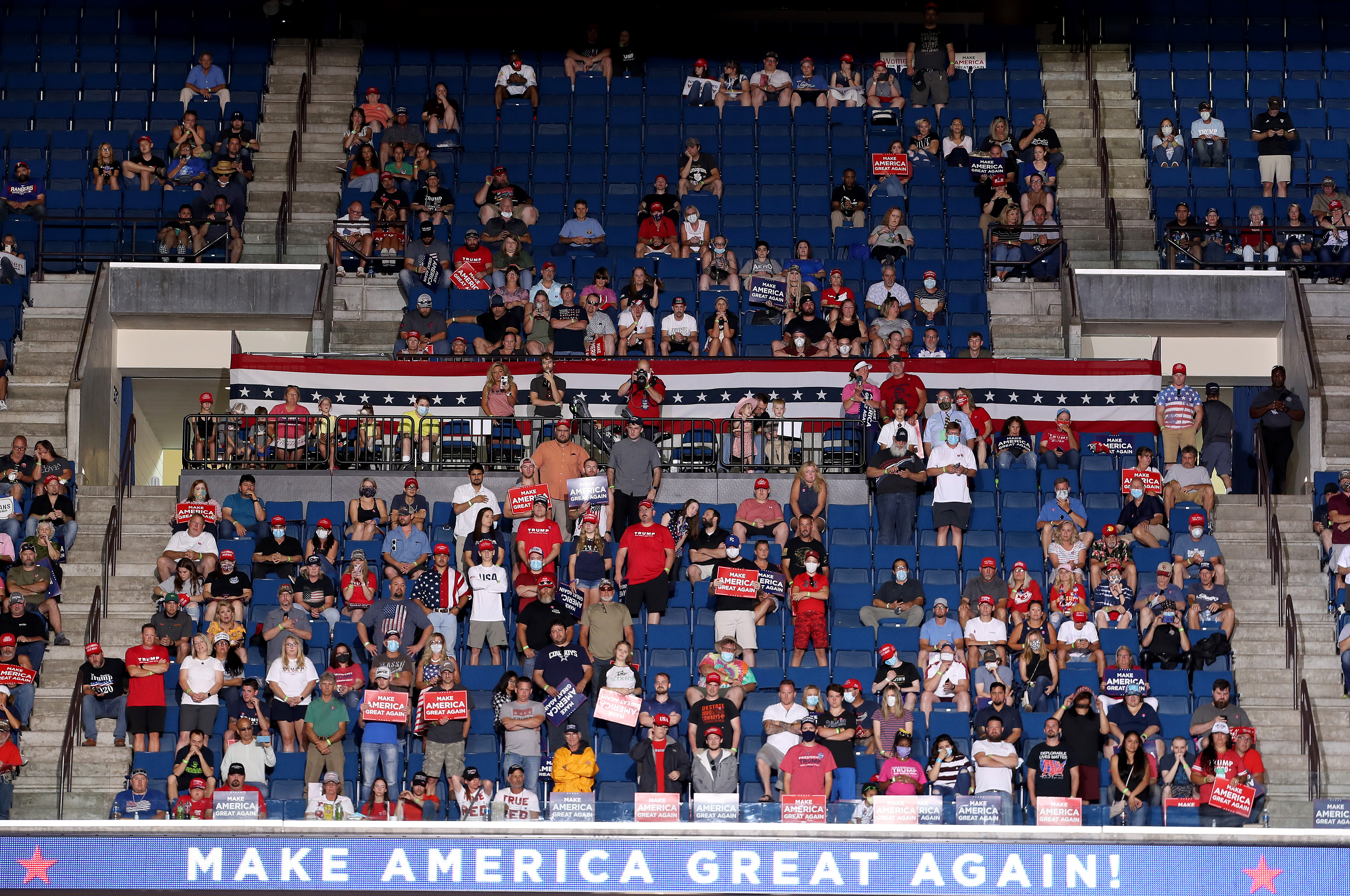 TULSA, OKLAHOMA - JUNE 20: Supporters listen as U.S. President Donald Trump speaksat  a campaign rally at the BOK Center, June 20, 2020 in Tulsa, Oklahoma. Trump is holding his first political rally since the start of the coronavirus pandemic at the BOK Center today while infection rates in the state of Oklahoma continue to rise. (Photo by Win McNamee/Getty Images)
