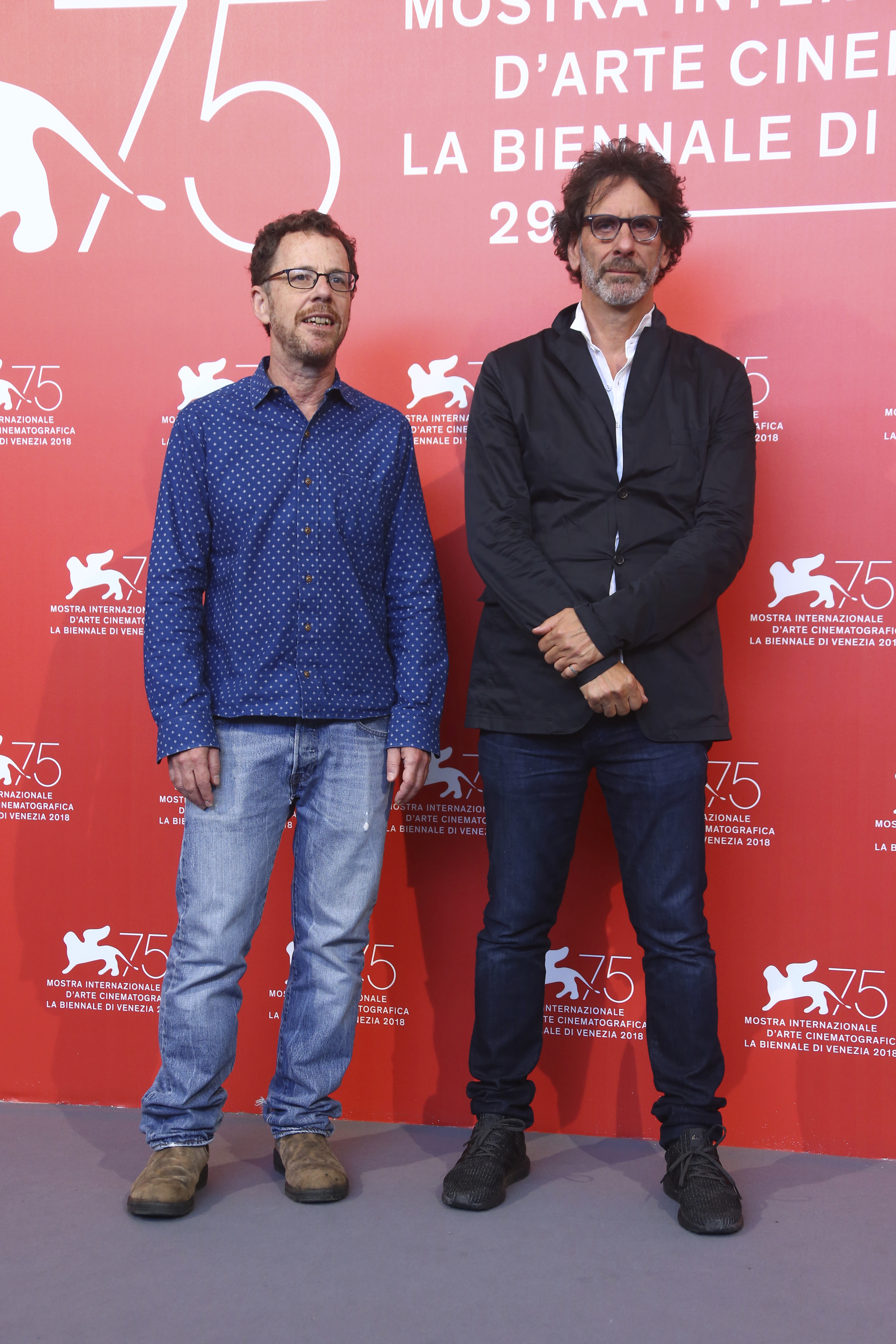 Directors Ethan Coen, left, and Joel Coen pose for photographers at the photo call for the film 'The Ballad of Buster Scruggs' at the 75th edition of the Venice Film Festival in Venice, Italy, Friday, Aug. 31, 2018. (Photo by Joel C Ryan/Invision/AP)