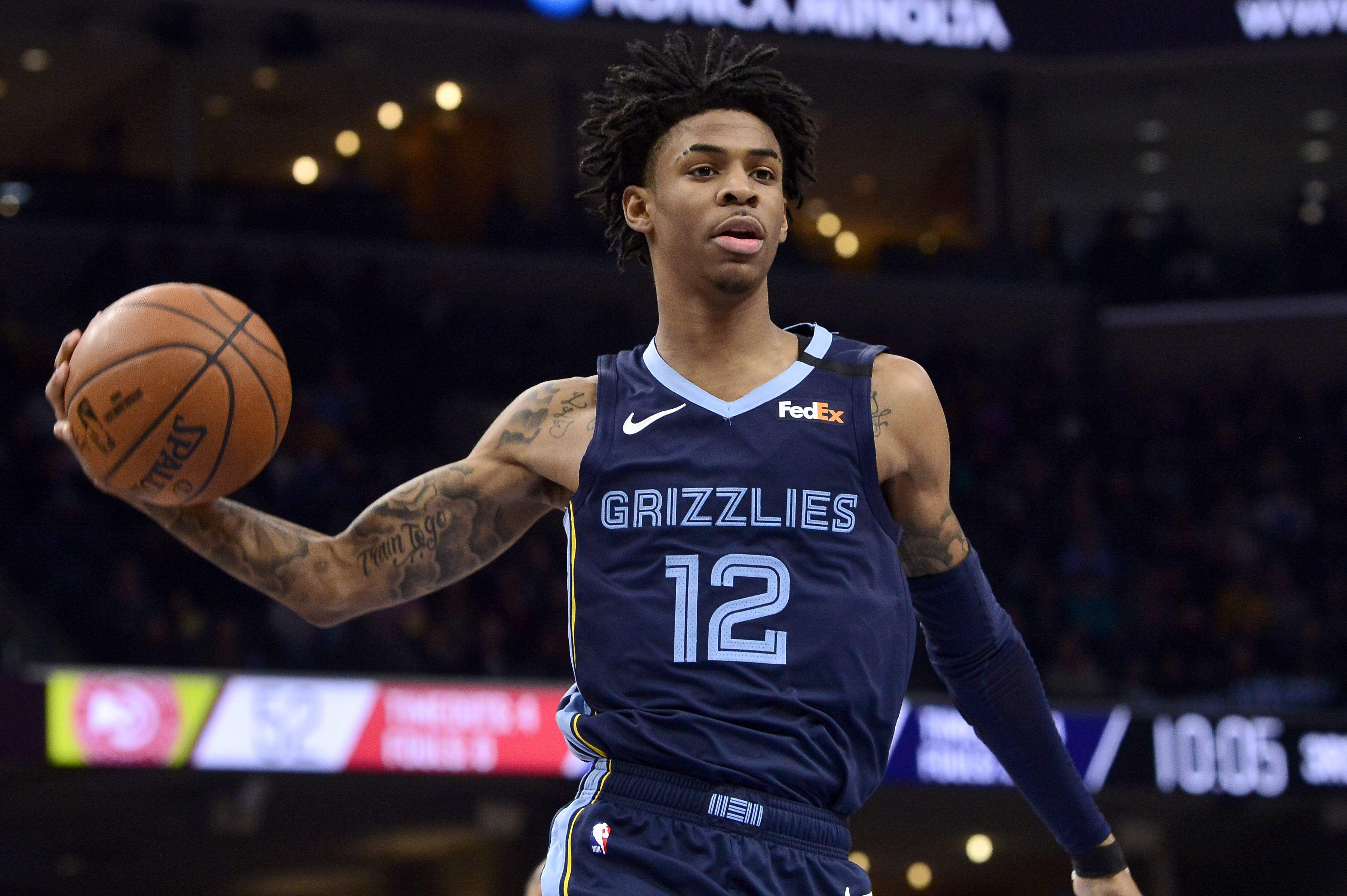 Memphis Grizzlies guard Ja Morant (12) plays in the second half of an NBA basketball game against the Atlanta Hawks Saturday, March 7, 2020, in Memphis, Tenn. (AP Photo/Brandon Dill)
