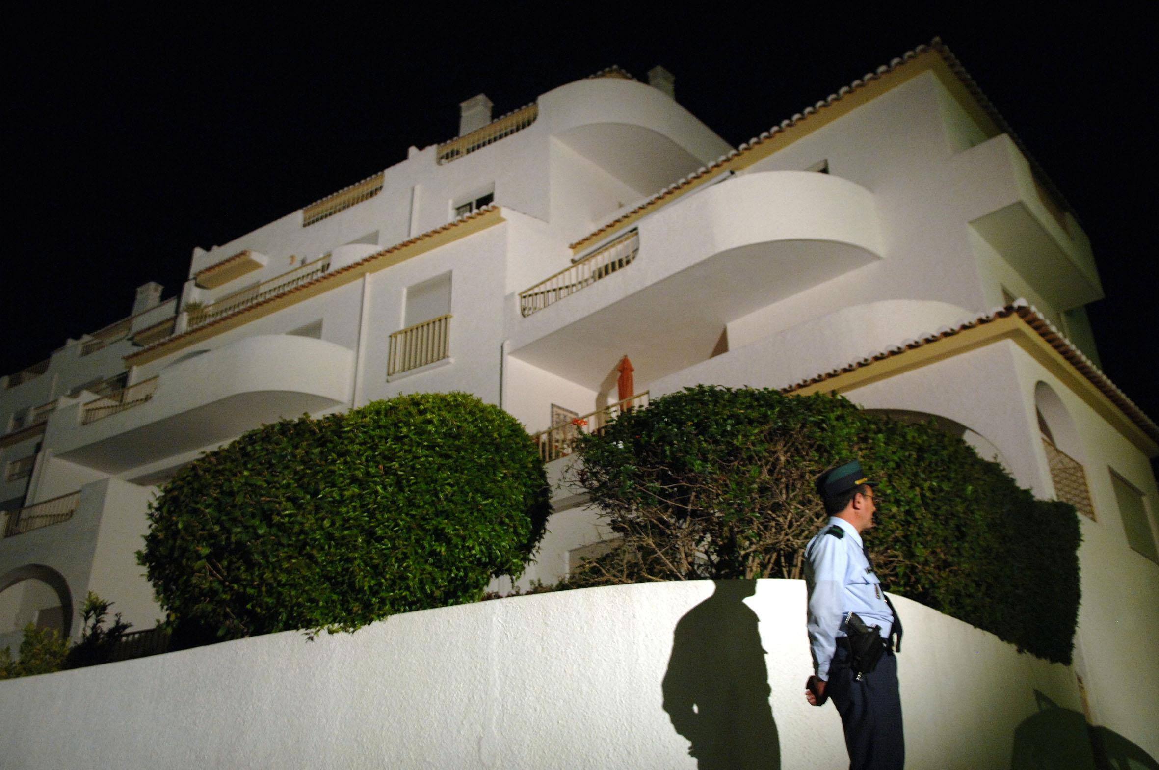 EMBARGOED TO 1915 WEDNESDAY JUNE 3 File photo dated 8/5/2007 of a police officer stands outside the apartment at the Ocean Club Hotel in Luz, Portugal, where Madeleine McCann went missing. A German prisoner has been identified as a suspect in the disappearance of Madeleine, detectives have revealed. The Metropolitan Police have not named the man, 43, who is described as white with short blond hair, possibly fair, and about 6ft tall with a slim build.