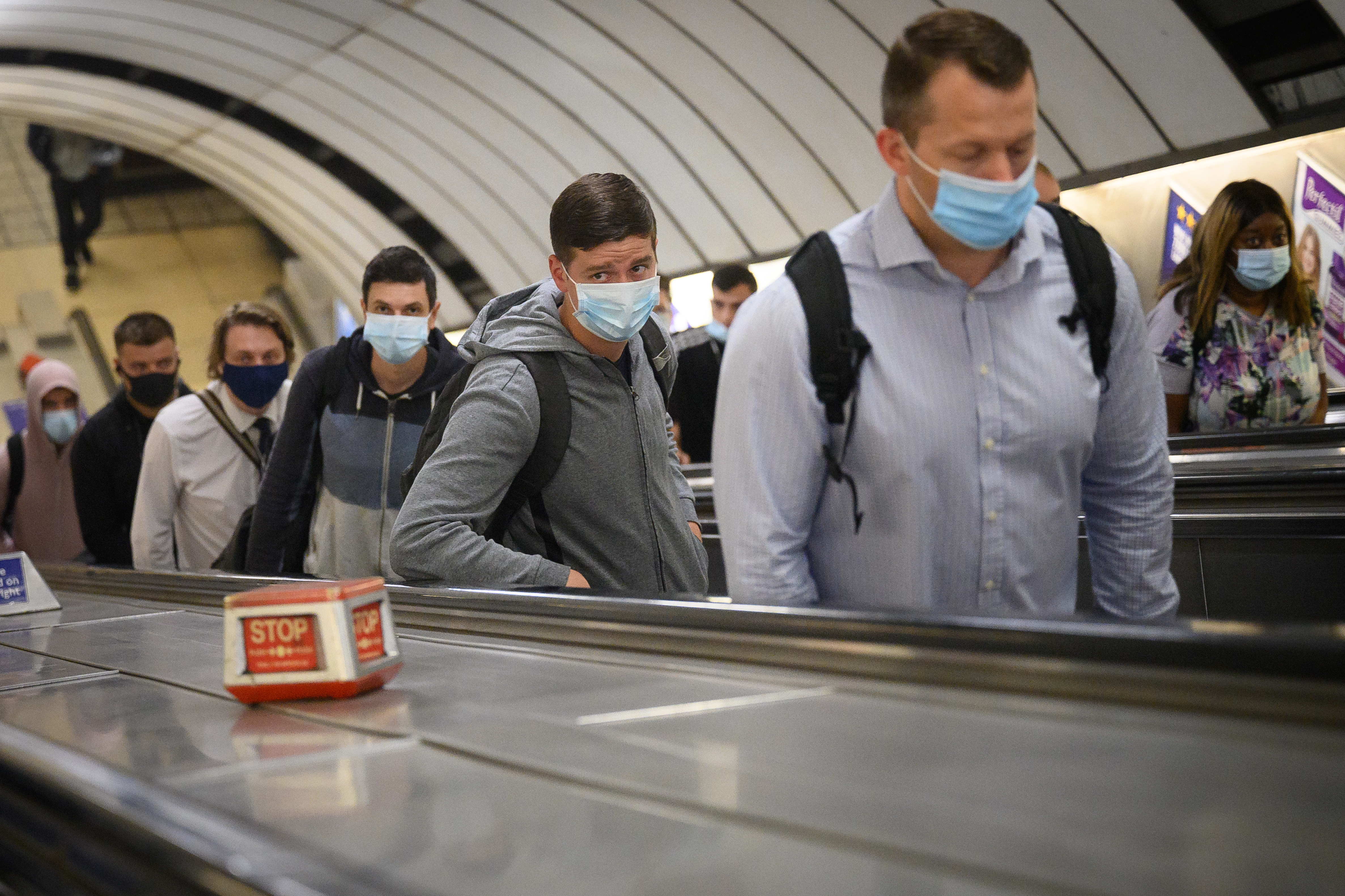 LONDON, ENGLAND - JUNE 15: Commuters wear face masks as they pass through Vauxhall underground station on the first day of their mandatory use while travelling on public transport, on June 15, 2020 in London, England. The British government have relaxed coronavirus lockdown laws significantly from Monday June 15, allowing zoos, safari parks and non-essential shops to open to visitors.  Places of worship will allow individual prayers and protective facemasks become mandatory on London Transport.  (Photo by Leon Neal/Getty Images)