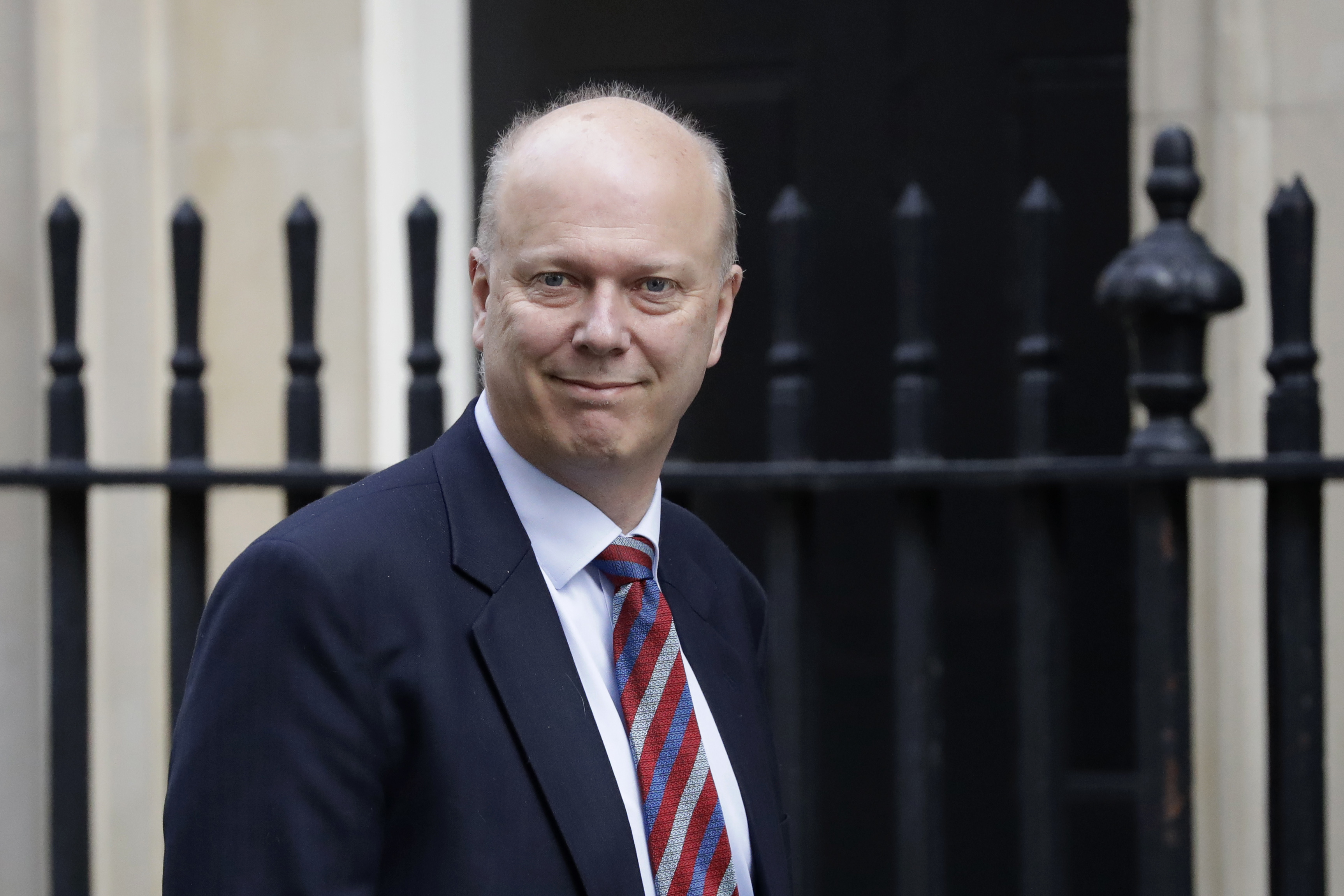 Britain's Transport Secretary Chris Grayling arrives for a cabinet meeting at 10 Downing Street in London, Tuesday, March 26, 2019. (AP Photo/Matt Dunham)
