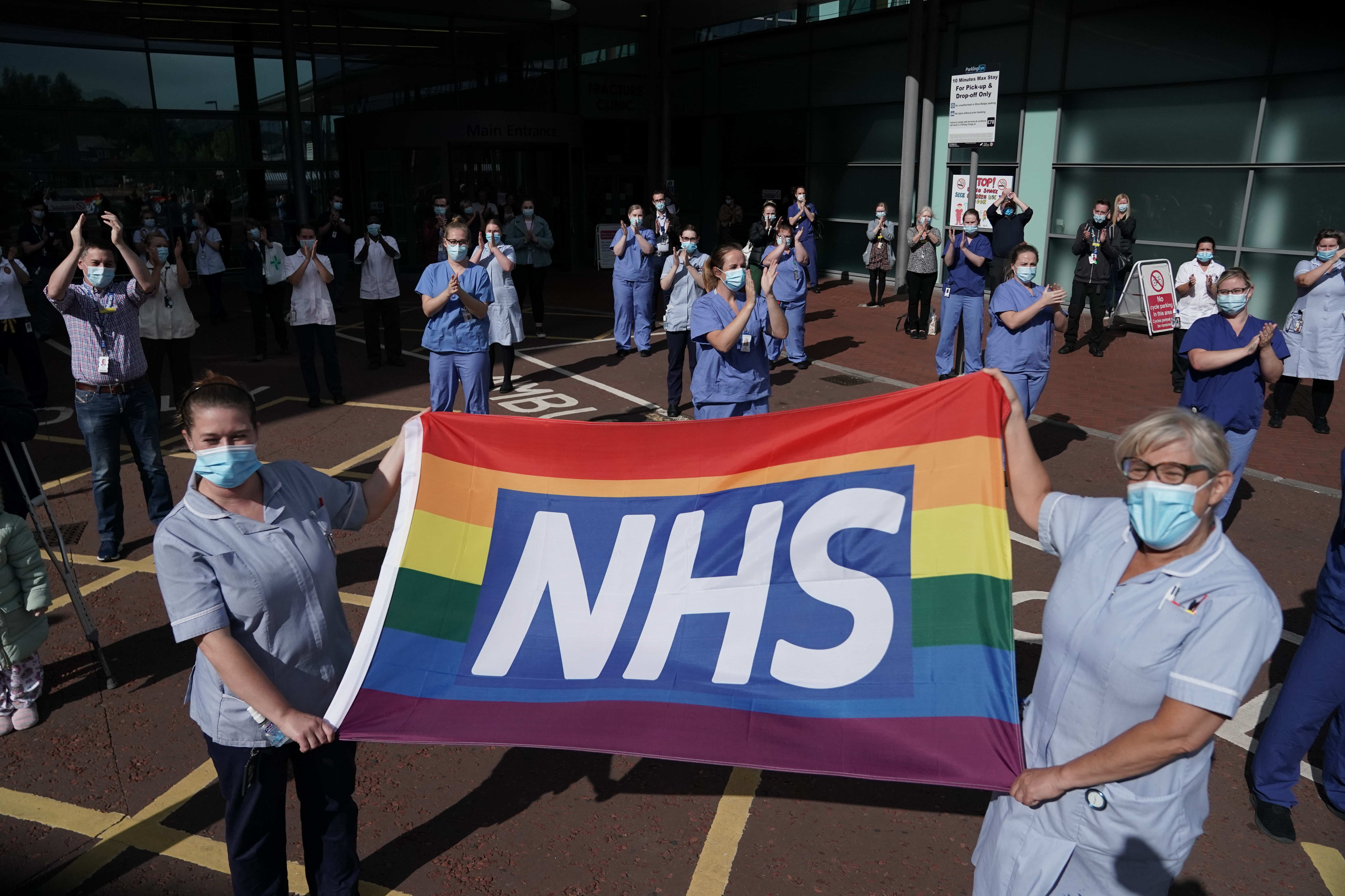 As part of the NHS birthday celebrations NHS staff outside Royal Victoria Infirmary, Newcastle, join in the pause for applause to salute the NHS 72nd birthday.