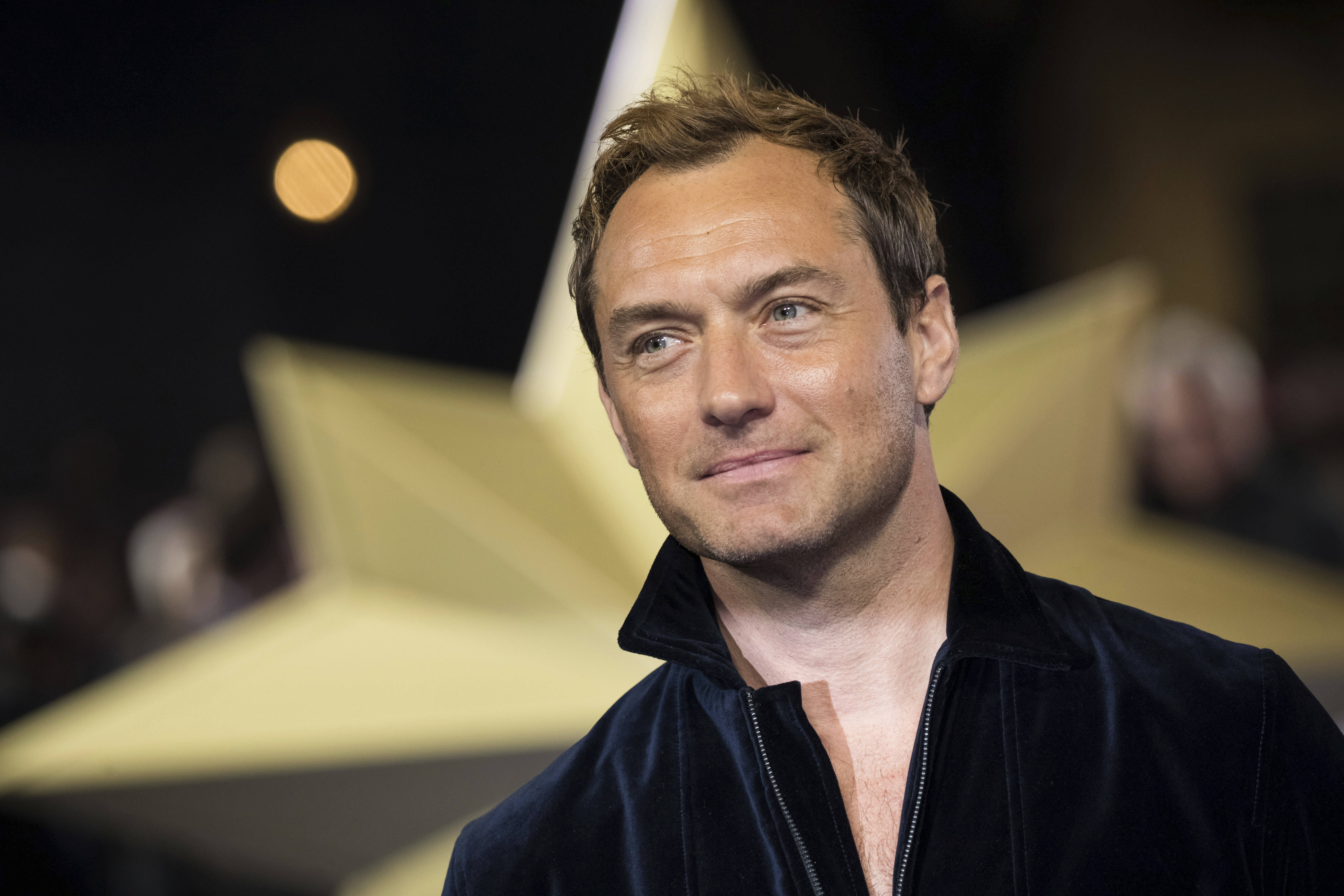 """FILE - In this Feb. 27, 2019 file photo, actor Jude Law poses for photographers upon arrival at the premiere of the film 'Captain Marvel', in London. Law is among the readers in an all-star recording of J.K. Rowling's """"The Tales of Beedle the Bard,"""" the first time her Harry Potter spinoff has been available as an audio book. (Photo by Vianney Le Caer/Invision/AP, File)"""