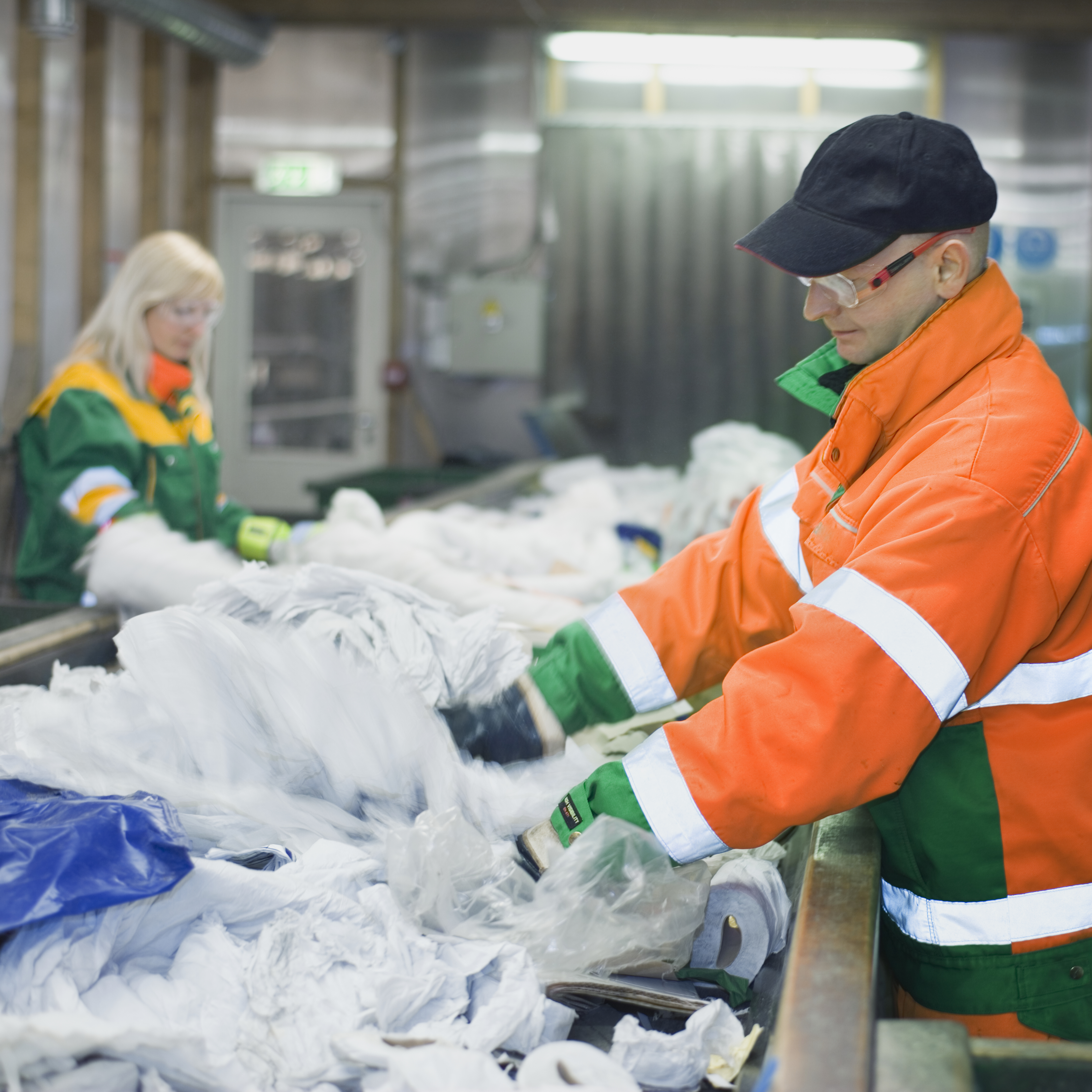 Workers sort through tons of recycling an hour, and are under strict instruction to send plastic bags...