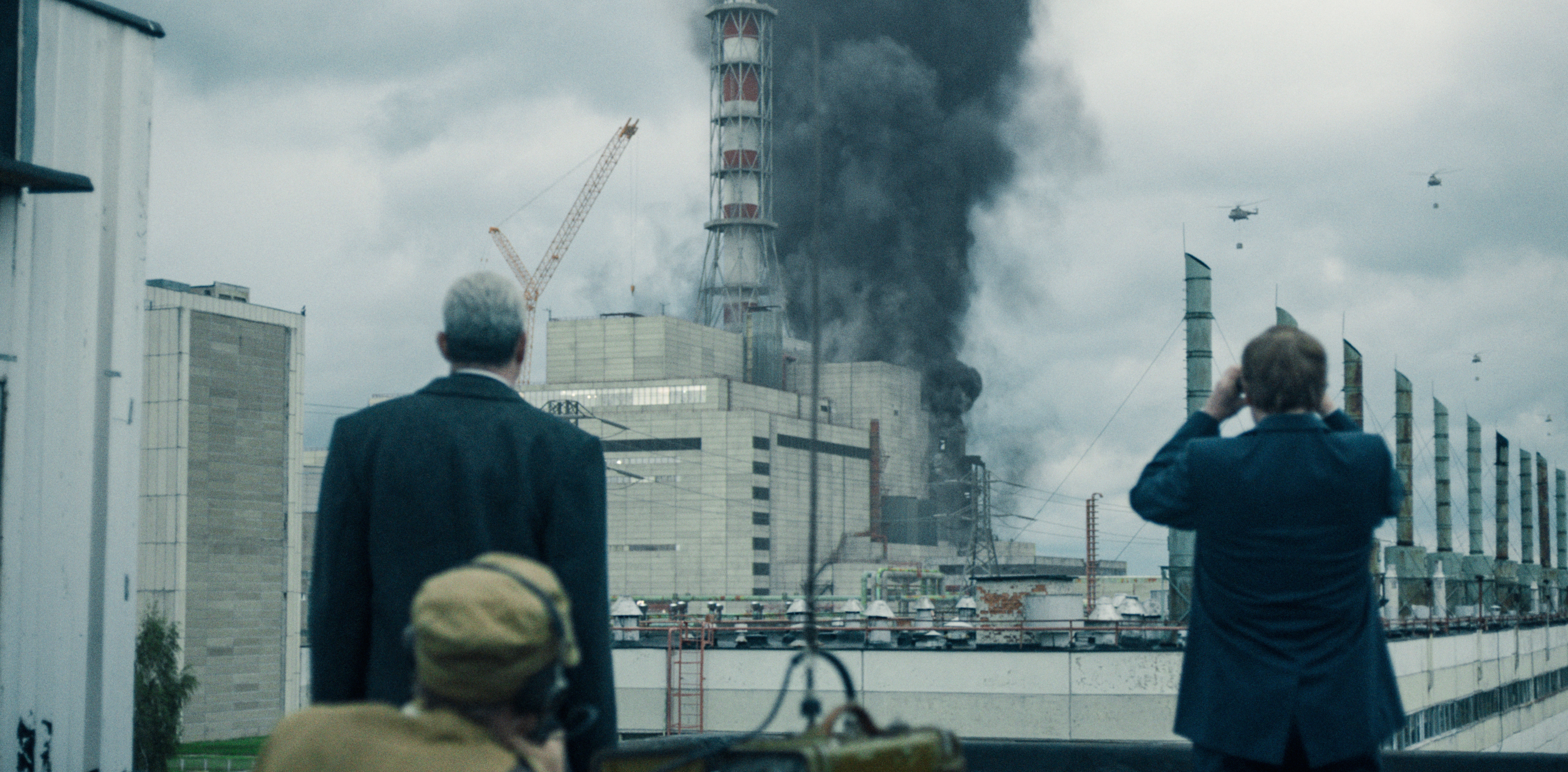 Military helicopters fly over the burning reactor in HBO's chilling Chernobyl. (HBO)