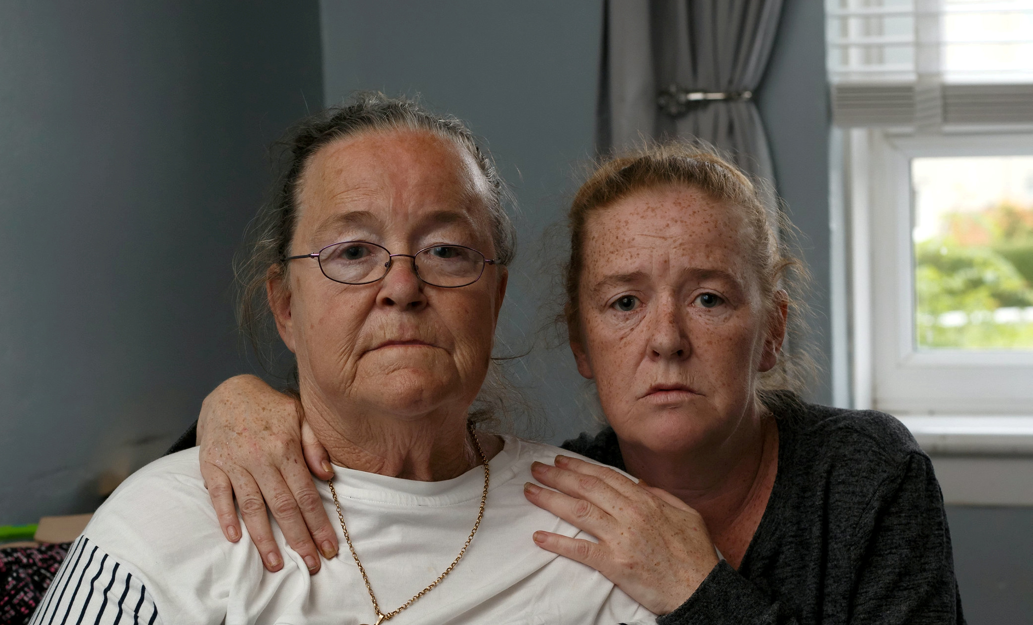 Margaret Doherty, 60, the mother of Sean Doherty, with daughter Joanne. The mother of Sean Doherty, 37, who took his own life, claims that the constant hounding of benefits staff over his Universal Credit led to his death. See SWNS story SWSCcredit. A man took his own life after being repeatedly hounded by benefits staff who claimed he was abusing Universal Credit, his grieving mum claims. Sean Doherty, 37, suffered a deep depression after the death of his father, who he had been a carer for. His family claim that staff from the Department of Work and Pensioners (DWP) accused Sean of continuing to receive a carers' allowance after the death of his dad. Tragically, his mum Margaret had taken Sean to A&E at Queen Elizabeth University Hospital in Glasgow after becoming concerned he was suicidal, five days before he died on Thursday, June 6.