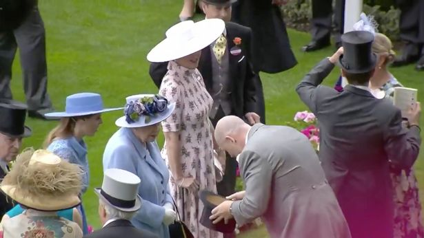 Mike Tindall removed his top hat as he greeted the Queen and made her laugh with his pre-planned gag.