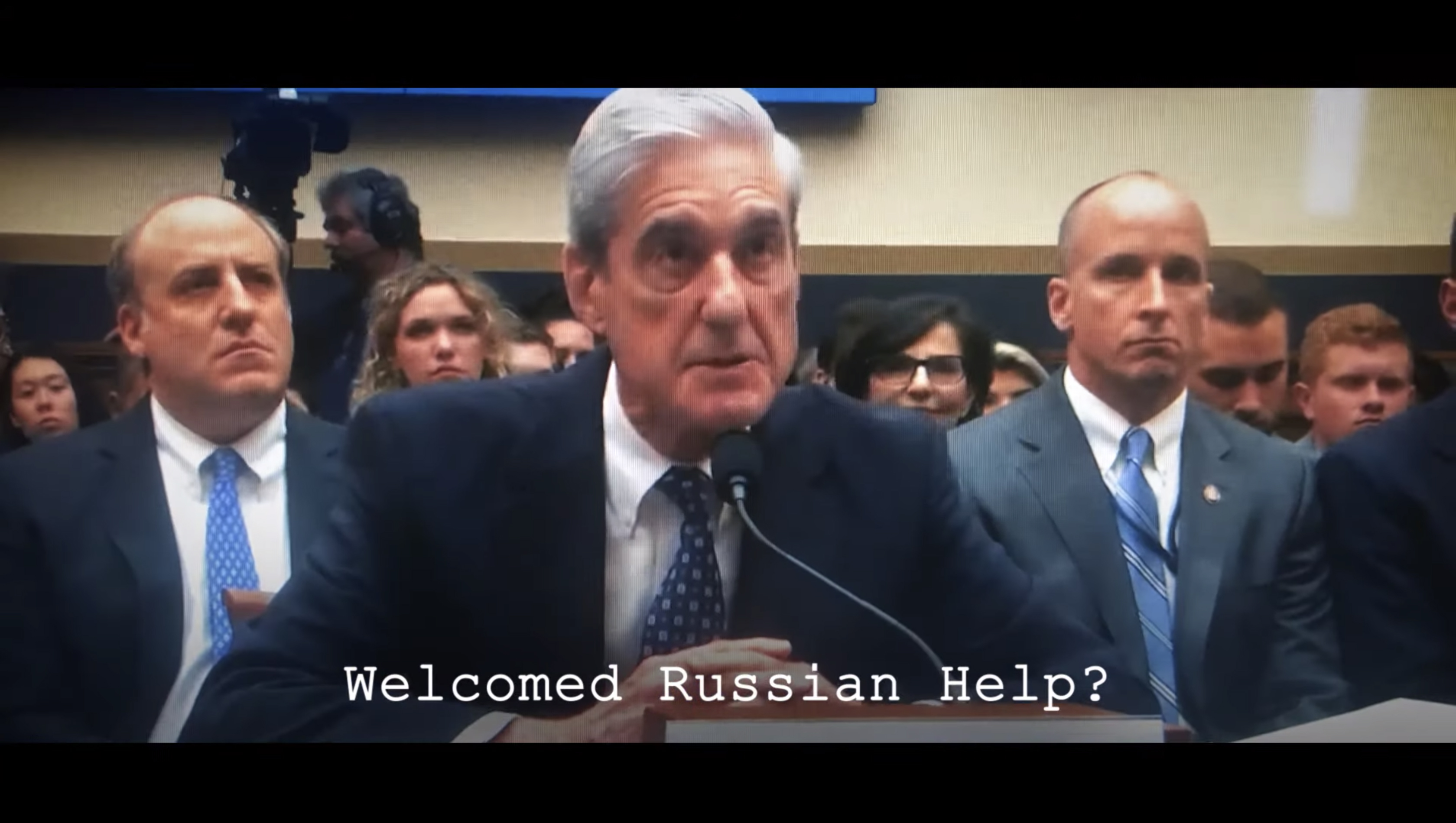 A still from a new TV ad by Need to Impeach. (via YouTube)
