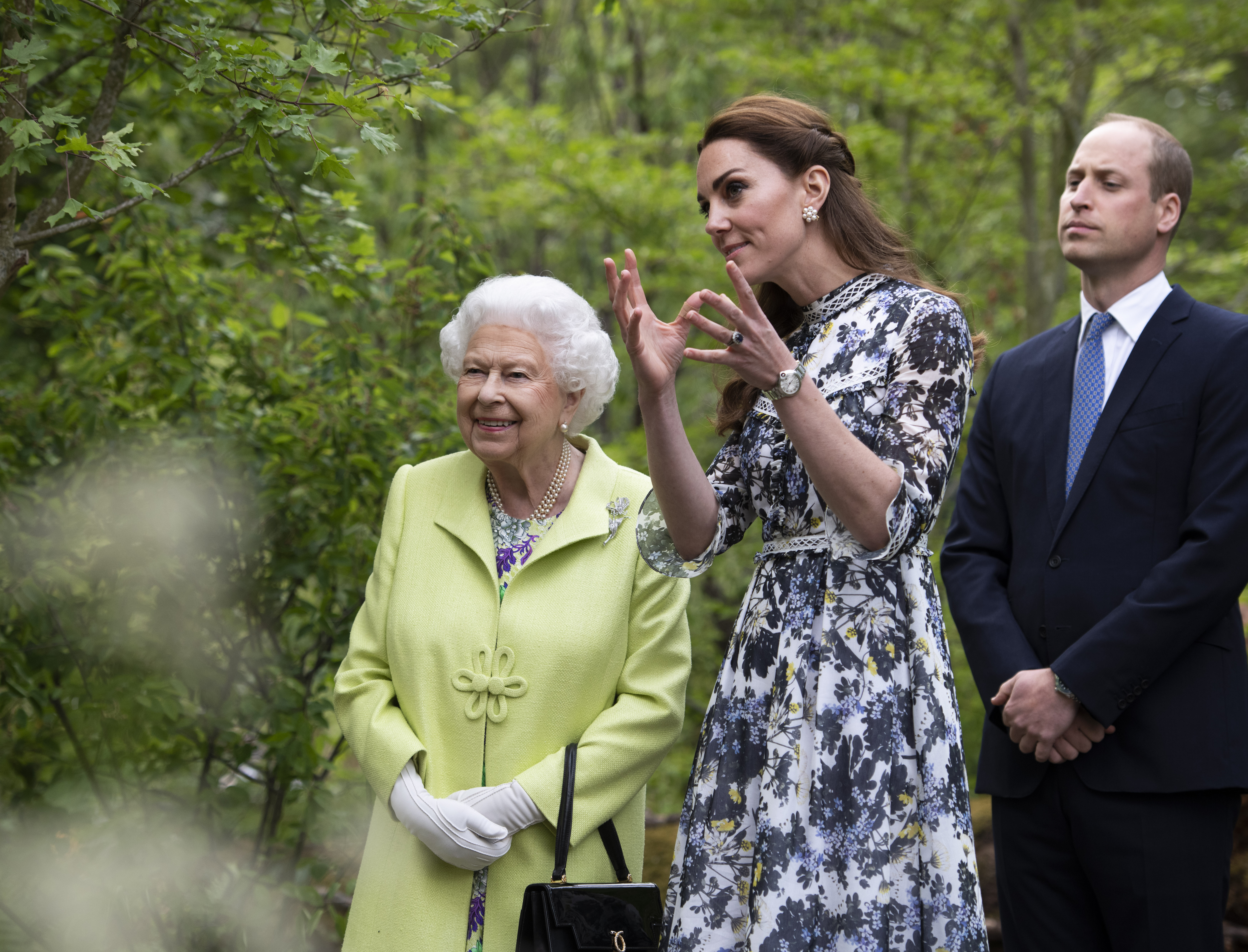 Kate shows the Queen and William around her Chelsea Flower Show garden in May. [Photo: PA]