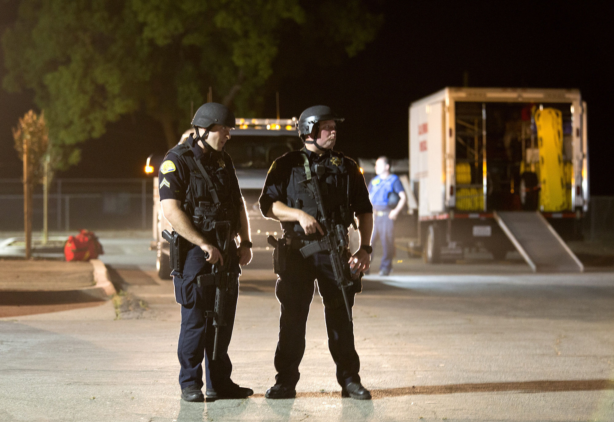 Police officers dressed in SWAT gear stand guard at the first aid center at Gilroy High School following a shooting at the Gilroy Garlic Festival in California (Picture: AP)
