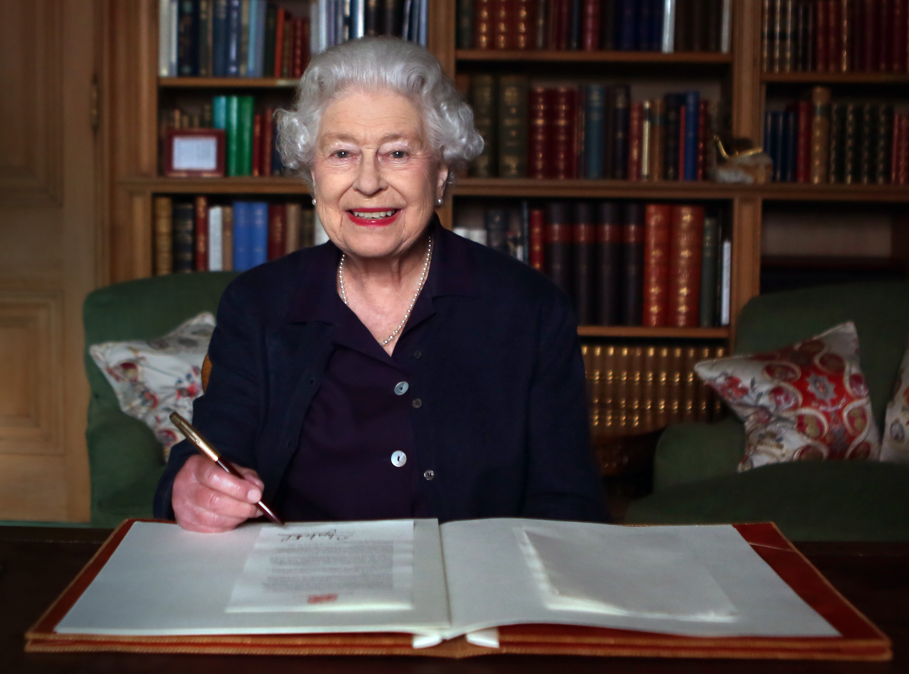 The Queen sitting at her desk in Balmoral in 2013. [Photo: PA]