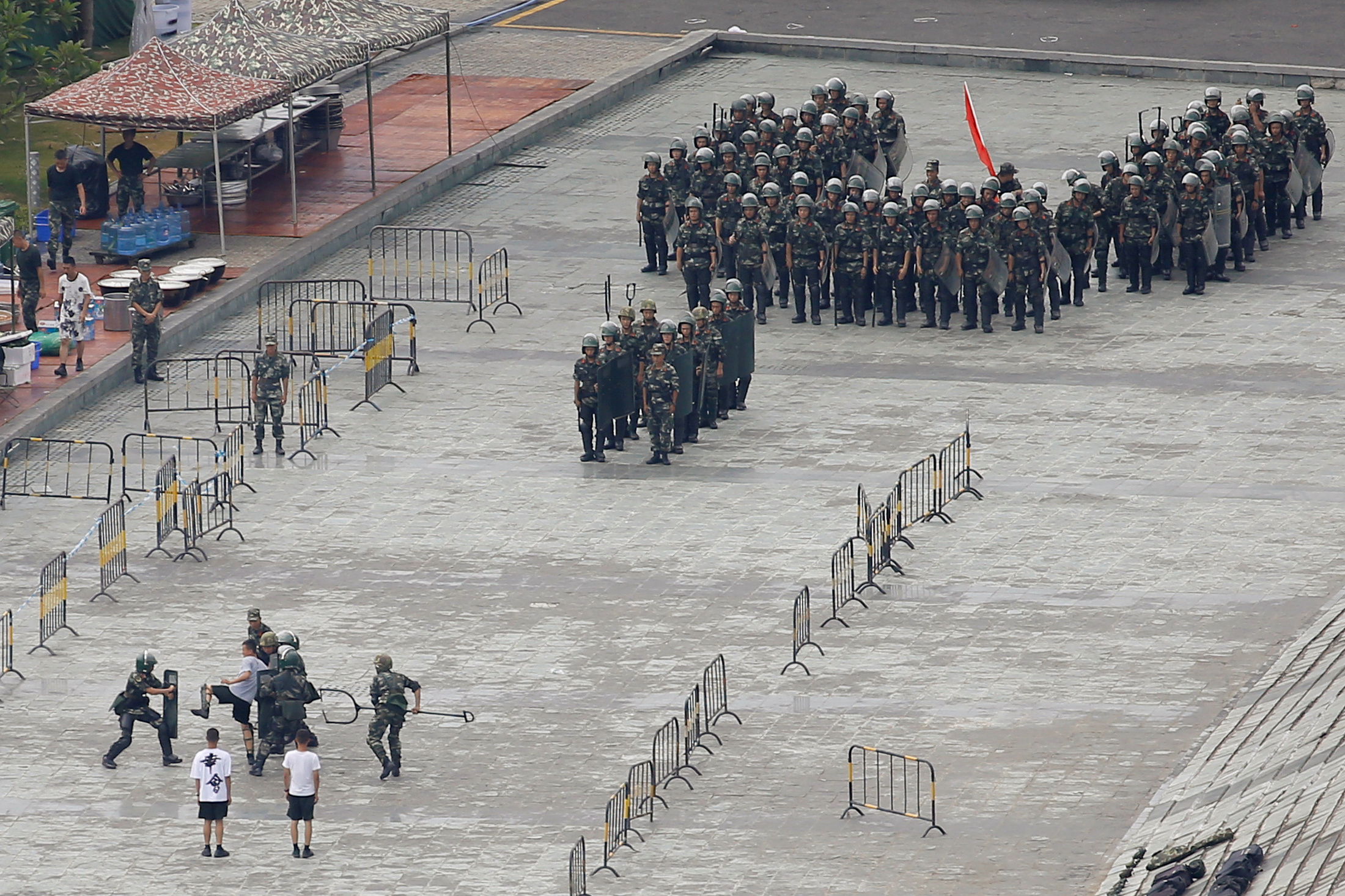 Chinese police have been practicing with terrifying fork devices amid protests in Hong Kong. (Reuters)