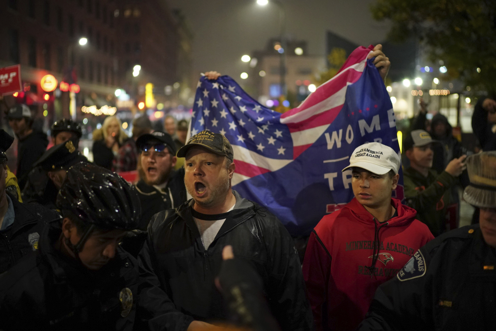 Pro-Trump people yell at protesters after the President's rally. (Photo: AP)