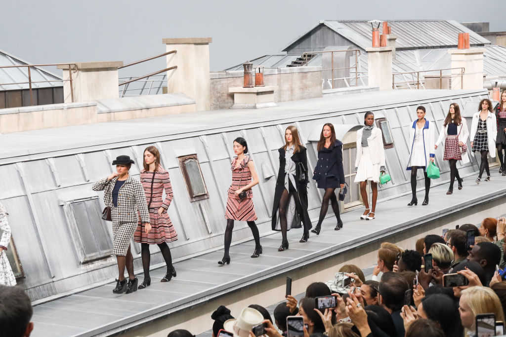 YouTuber Marie S'Infiltre crashing the Chanel catwalk. [Photo: Getty/AP]