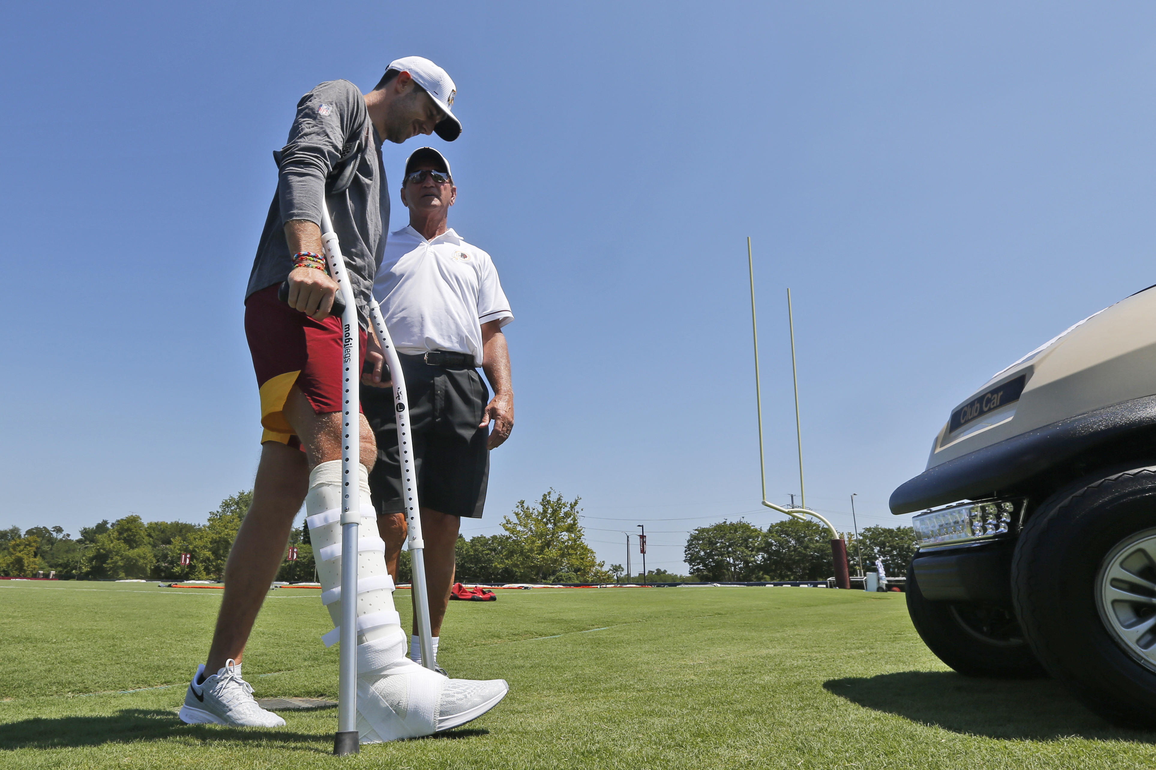 Washington's Alex Smith, left, reportedly has had 17 surgeries since breaking his right leg 11 months ago. (AP)