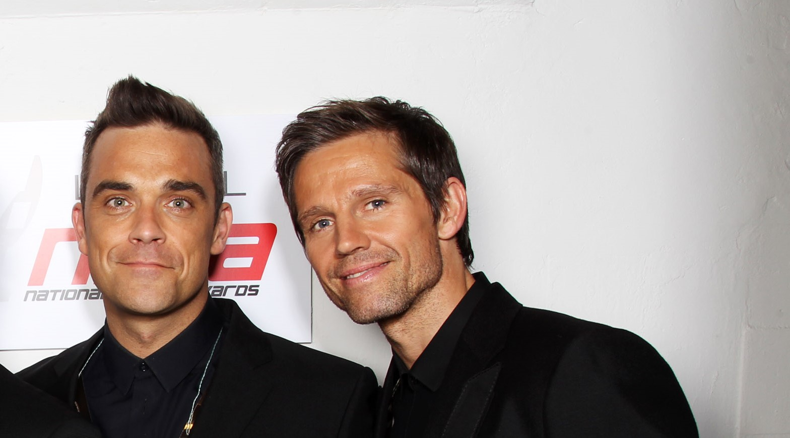 Take That's Robbie Williams and Jason Orange in 2011 (Credit: Getty Images)