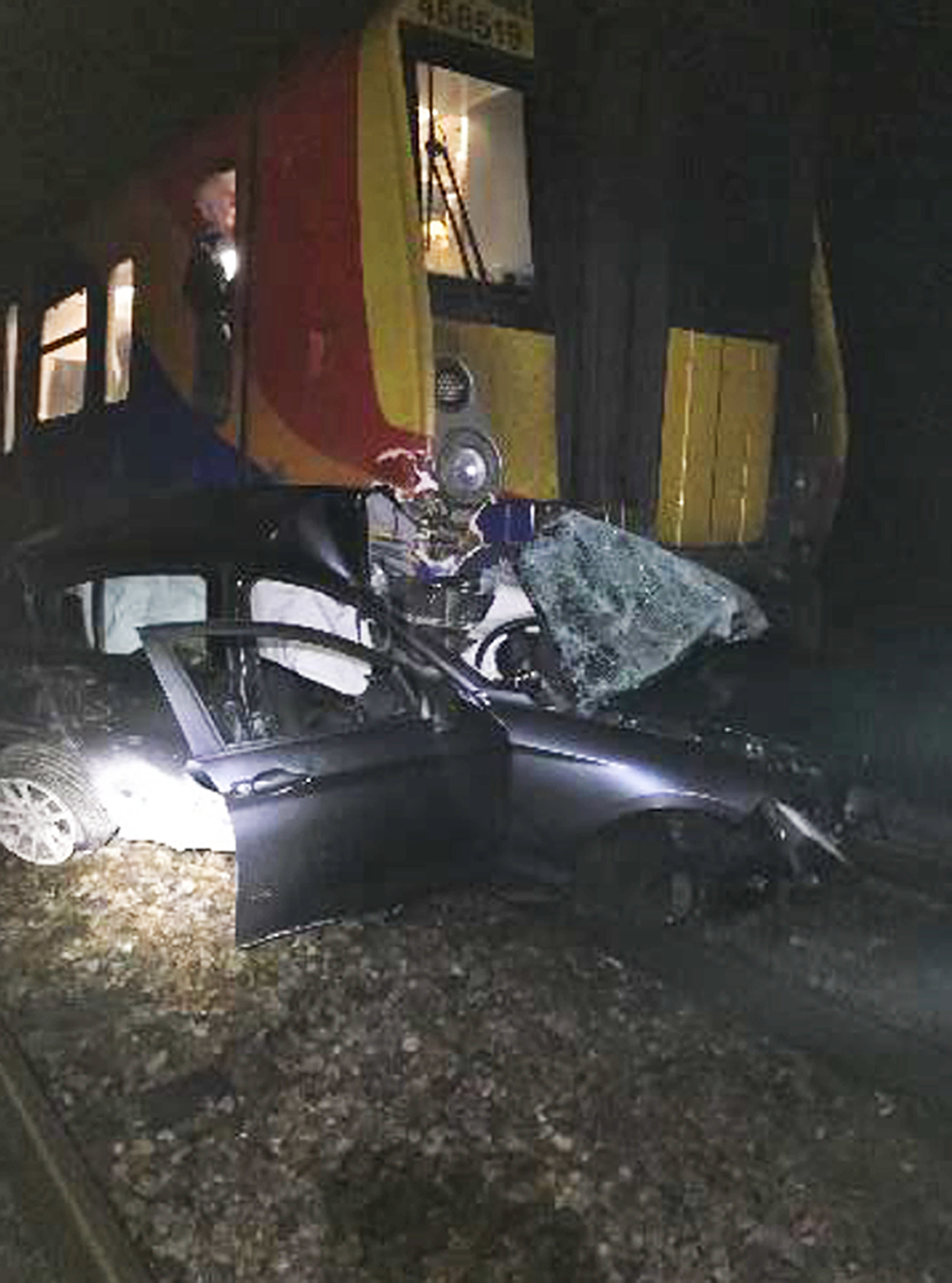 The driver escaped from the vehicle before the collision occurred at a level crossing in Wokingham, Berkshire (PA)