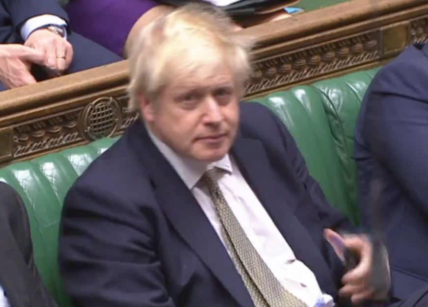Boris Johnson puts his phone in his pocket after being called out by Ian Blackford (Parliamentlive.tv)
