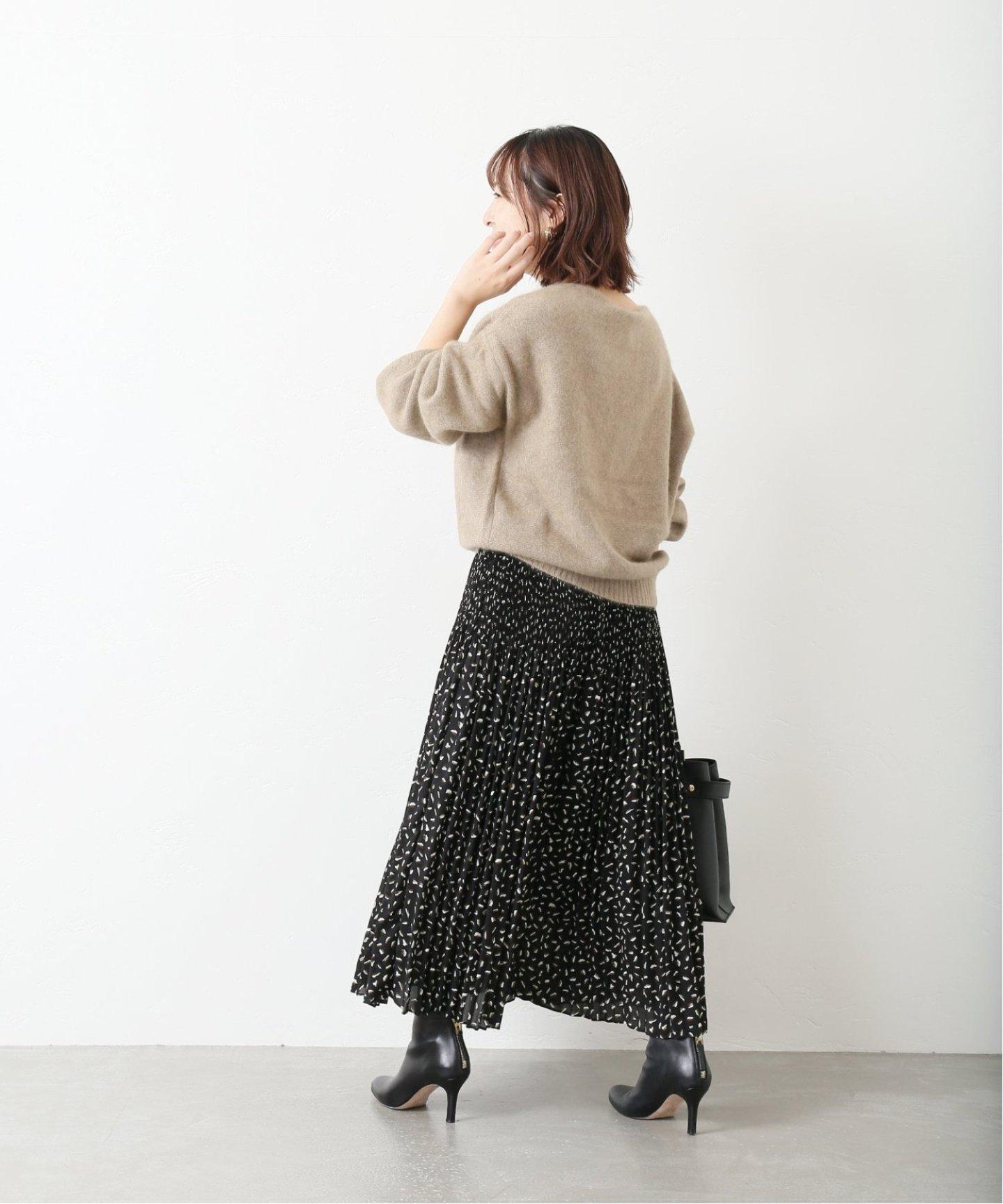 幾何的細小圖騰讓印花長裙俏皮中又多了幾分個性印象