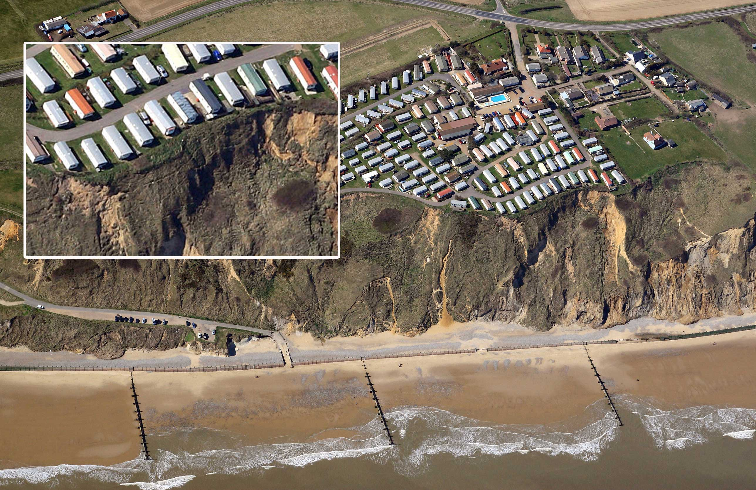 Seaside caravans were left teetering on the edge of a cliff after a huge landslide near Cromer in Norfolk (Picture: SWNS)