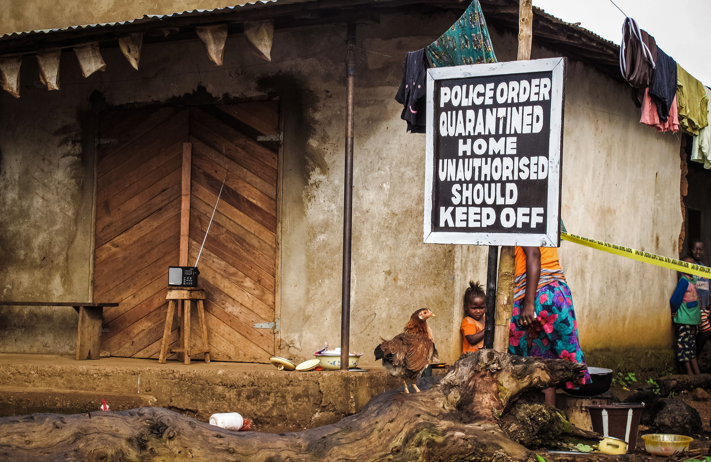 A home is quarantined in an effort to combat the spread of the Ebola virus, Port Loko, Sierra Leone, in 2014. (Photo: Michael Duff/AP)