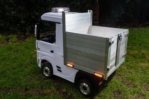 The 24-volt battery-powered four-wheel drive lorry has a plank aluminium body and flashing safety lights and is big enough for a child to sit in and drive. (SWNS)